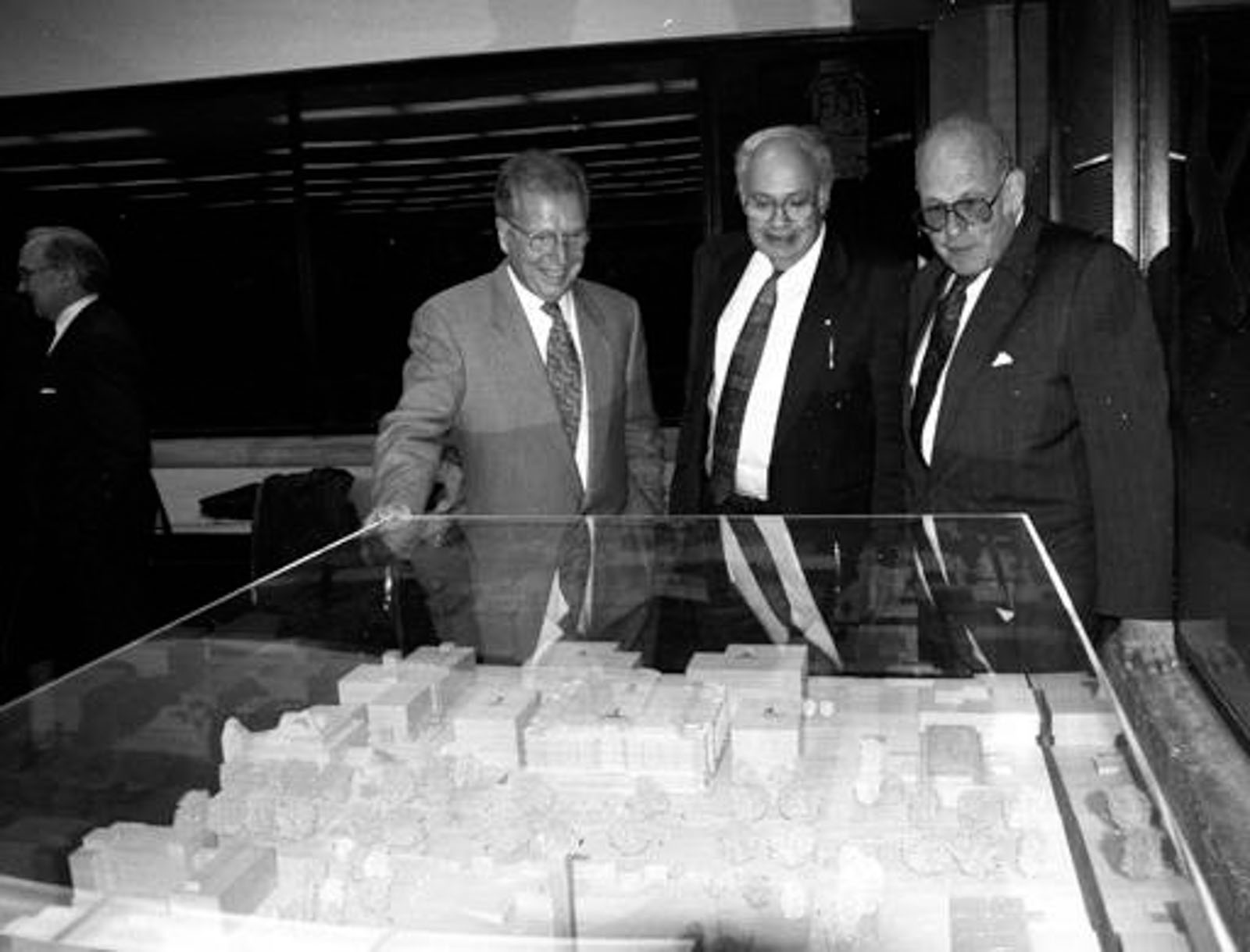 UBC President David Strangway, centre, and Walter Koerner, right, look at a model of Koerner Library.