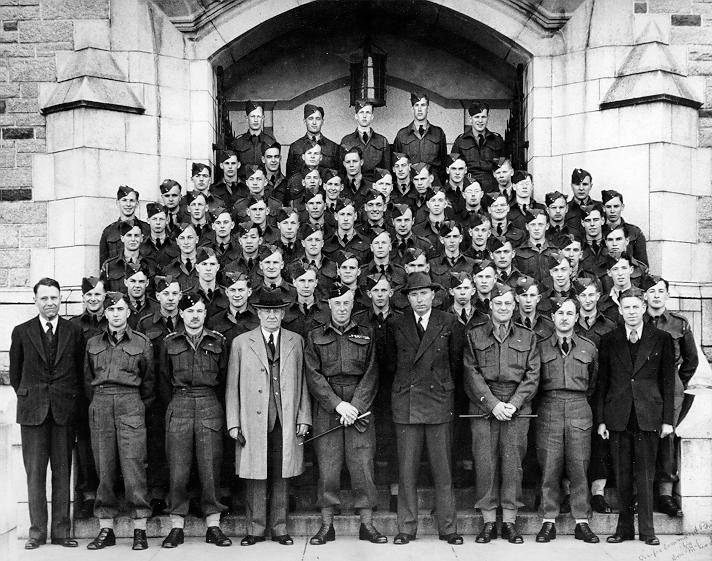 UBC students in uniform stand in front of Main Library (now Irving K. Barber Learning Centre) with Walter Gage, Leonard Klinck and Gordon Shrum.