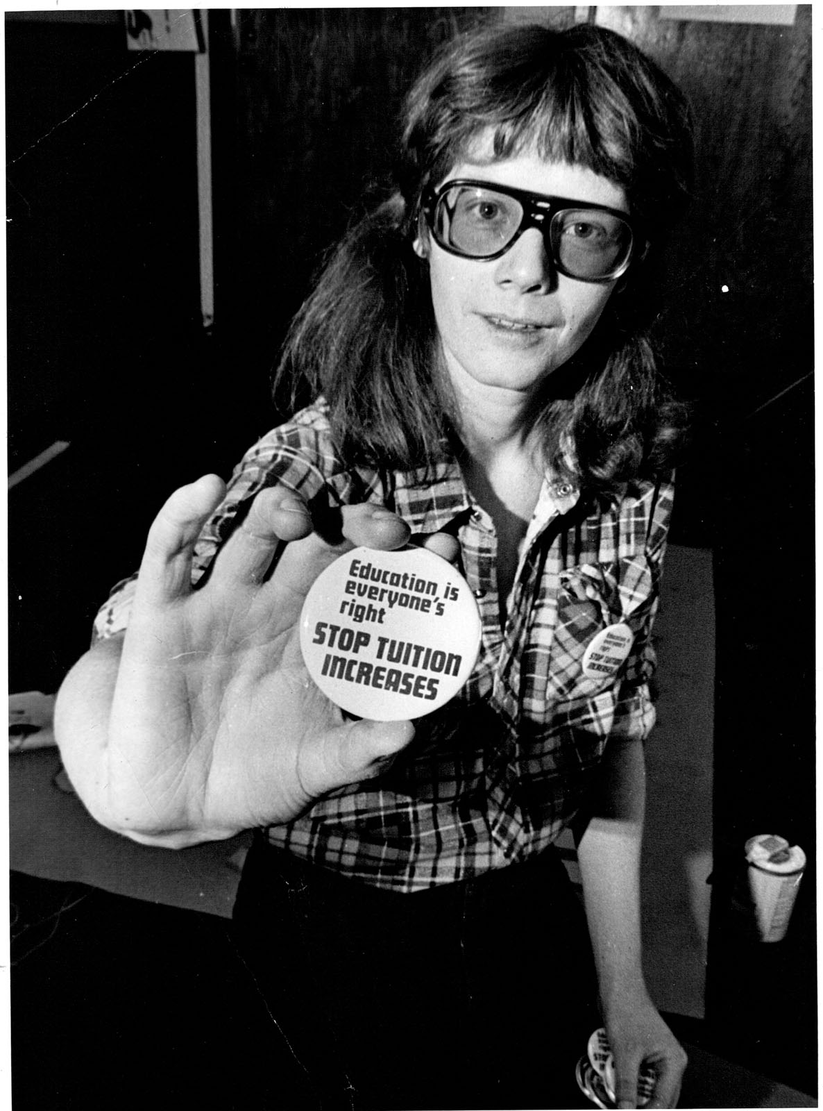 Lake Sagaris hands photographer tuition fee protest button Feb 1977