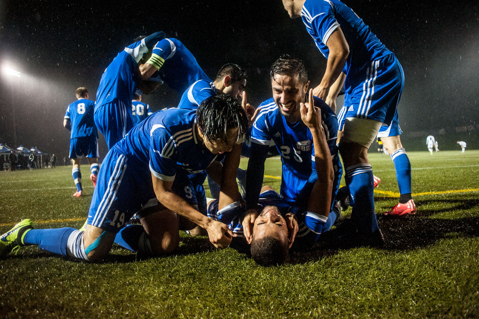 The team celebrates after scoring in the Canada West finals.