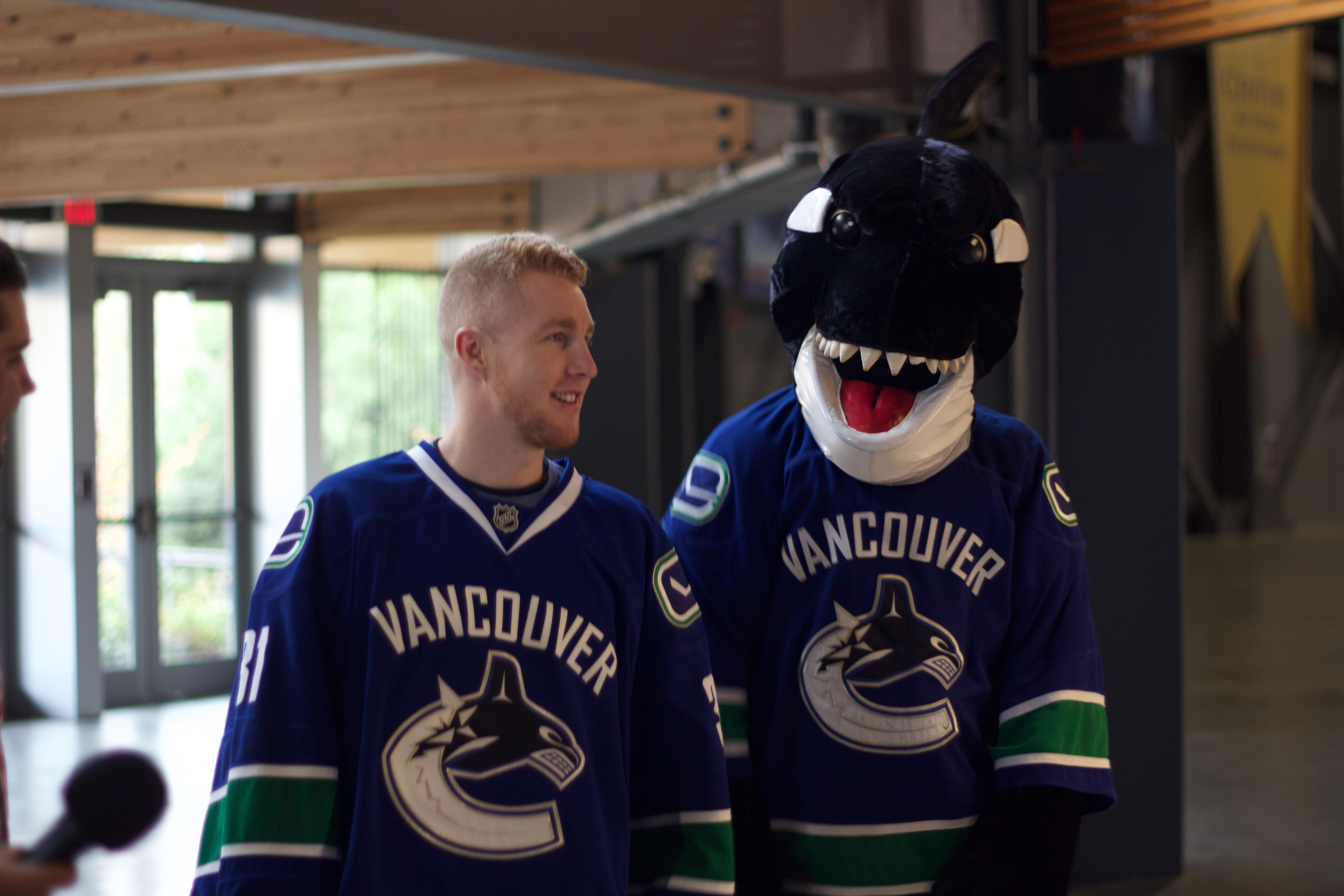 """Nice haircut Hewy,"" said Canucks mascot Fin, probably."