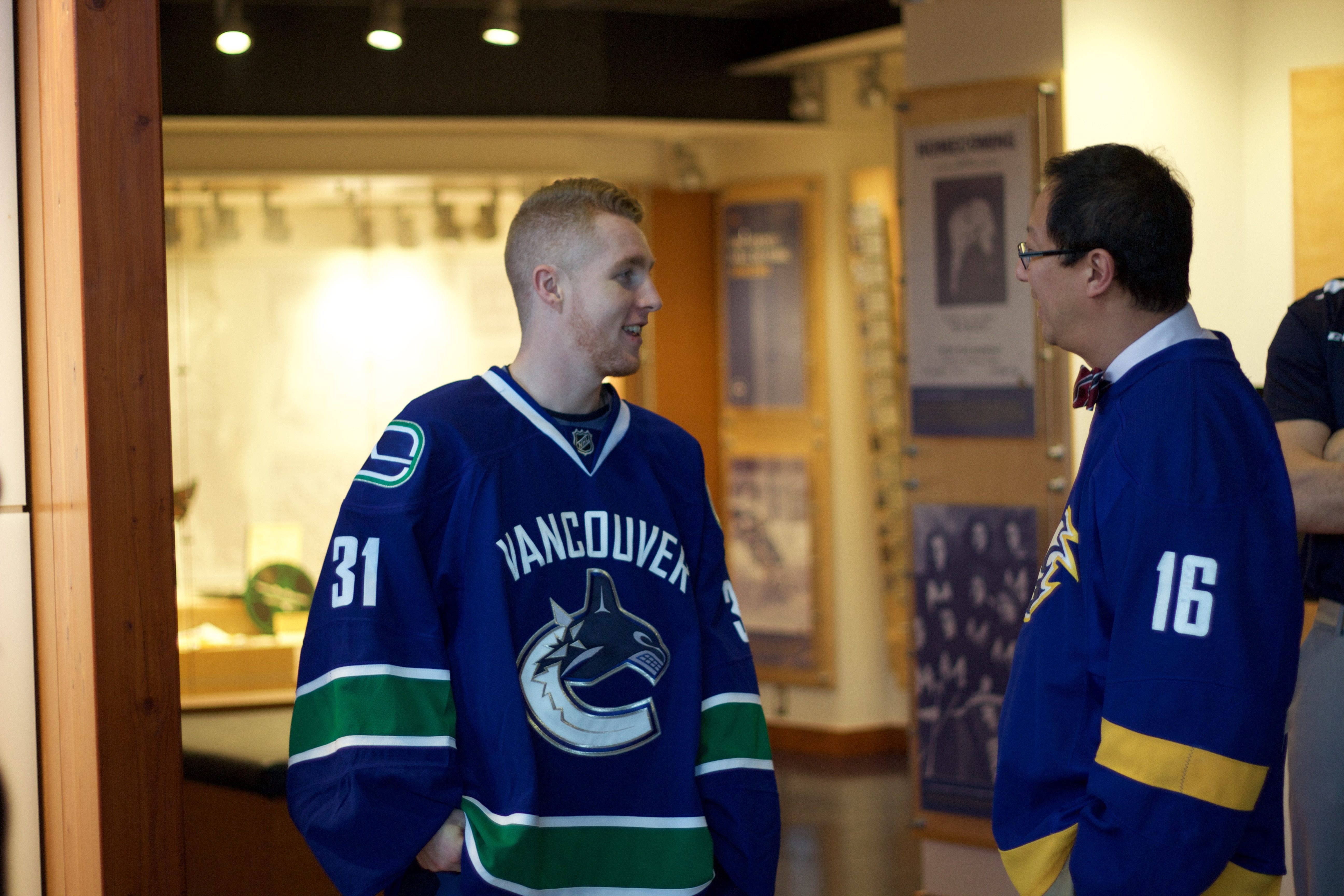 UBC goaltender Matt Hewitt and UBC President Santa Ono