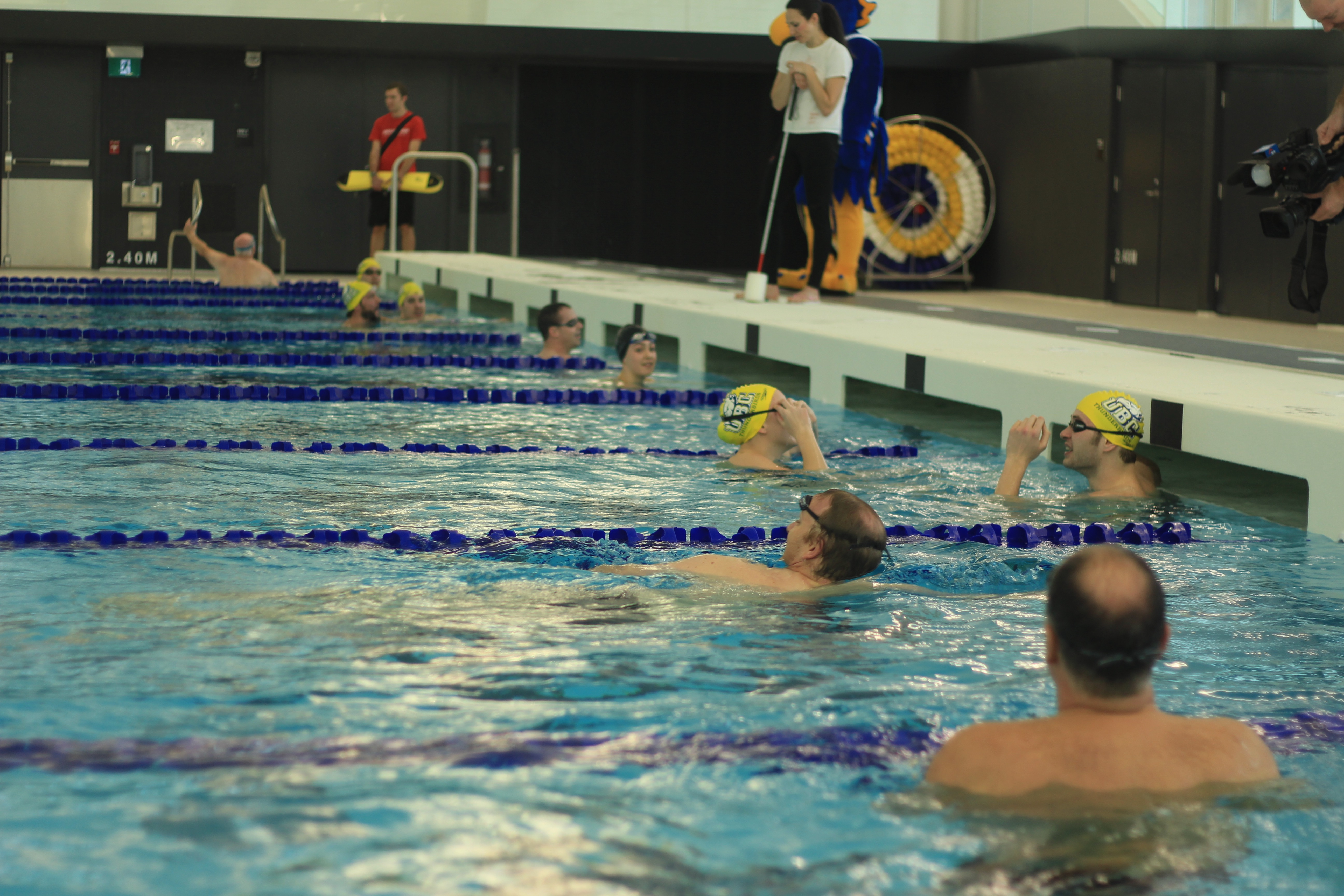 The first swim in the Aquatic Centre was a friendly between UBC Thunderbirds and alumni.