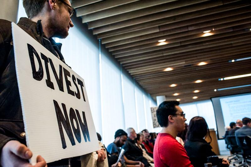 Divestment protestors attended the Board of Governors committee meeting in February 2016.