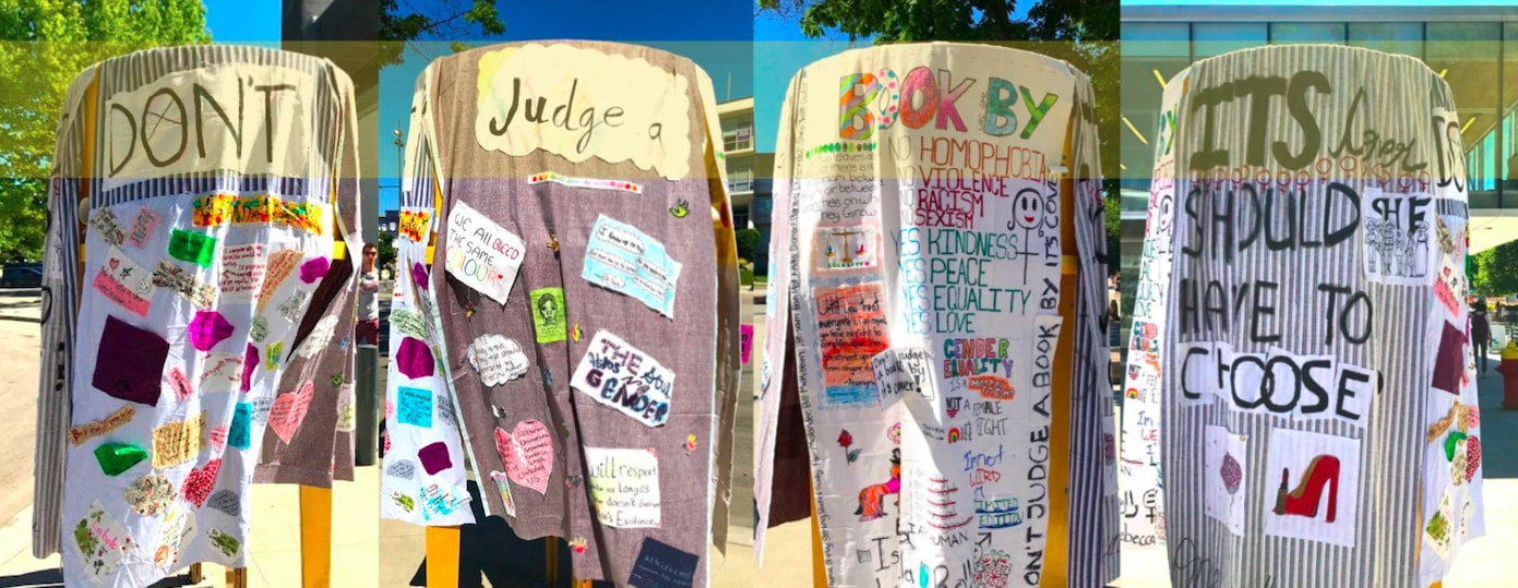 "Four fabric panels — spelling out ""don't judge a book by its cover"" — were fixed to the UBC free library outside of Michael Smith Labs."
