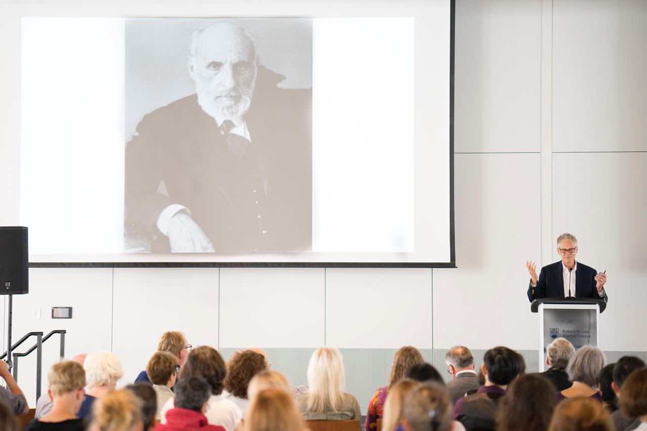 University of Southern California neuroscientist Dr. Larry Swanson speaks about Santiago Ramón y Cajal, pictured behind him, at the Robert H. Lee Alumni Centre.