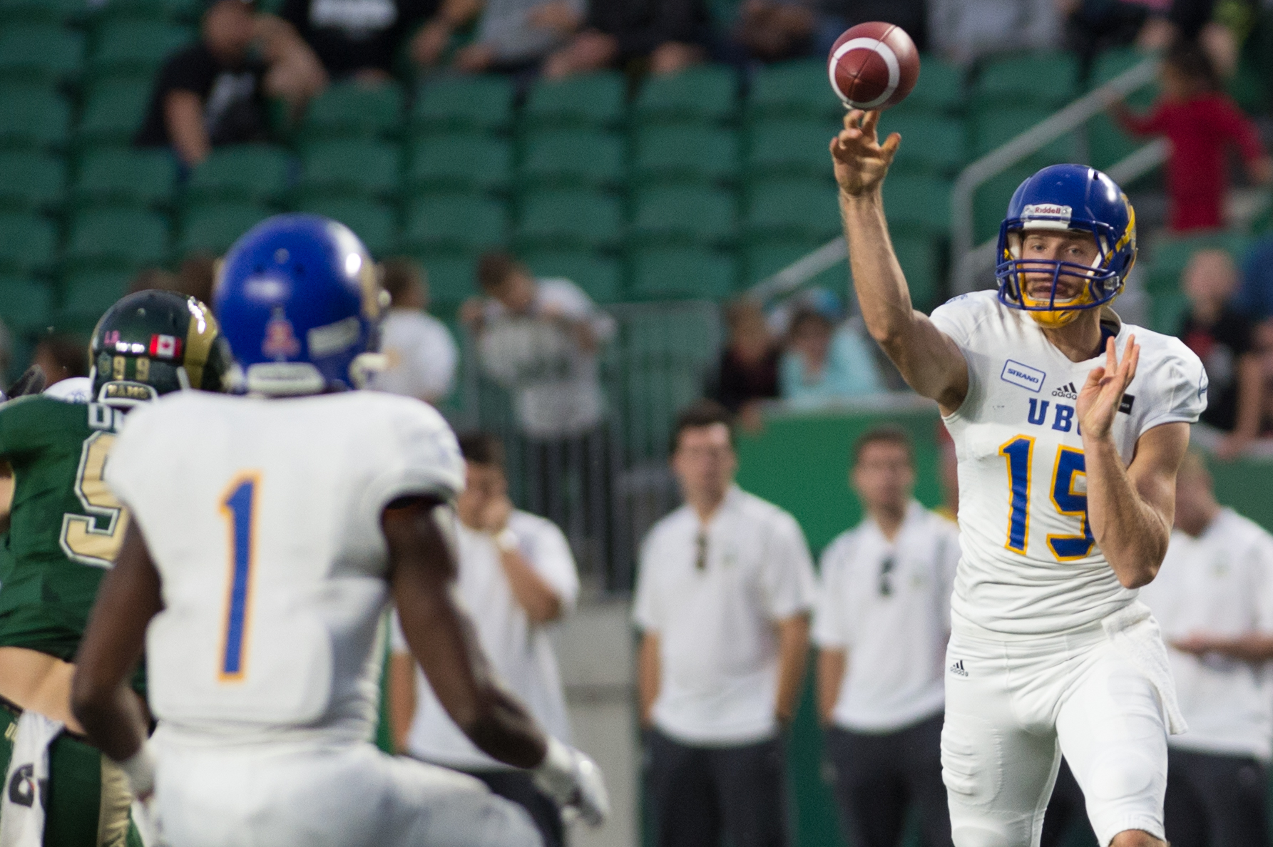 UBC's Michael O'Connor looks for the open throw to receiver Trivel Pinto.