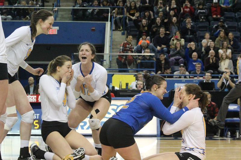 Vollyball alumnus Danielle Brisebois celebrates winning the 2017 U Sports women's volleyball championship.