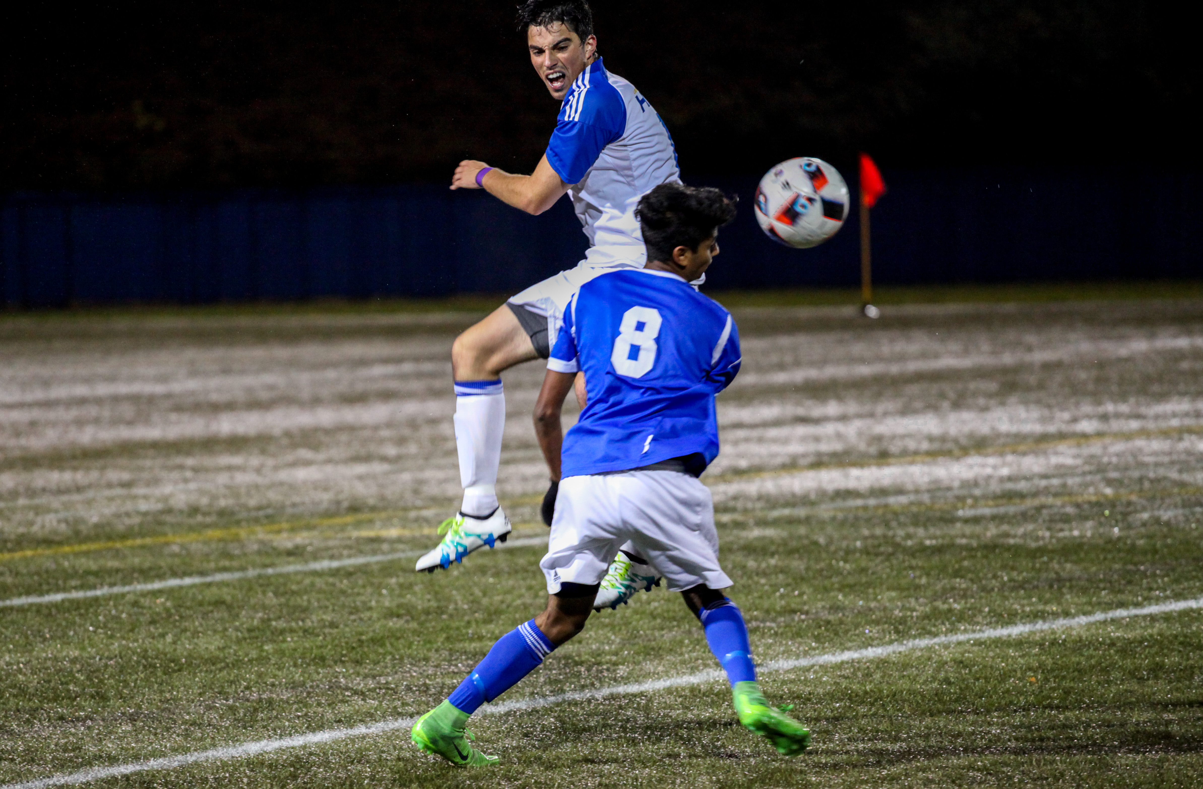UBC forward Zach Verhoven fights for the ball against UBCO.