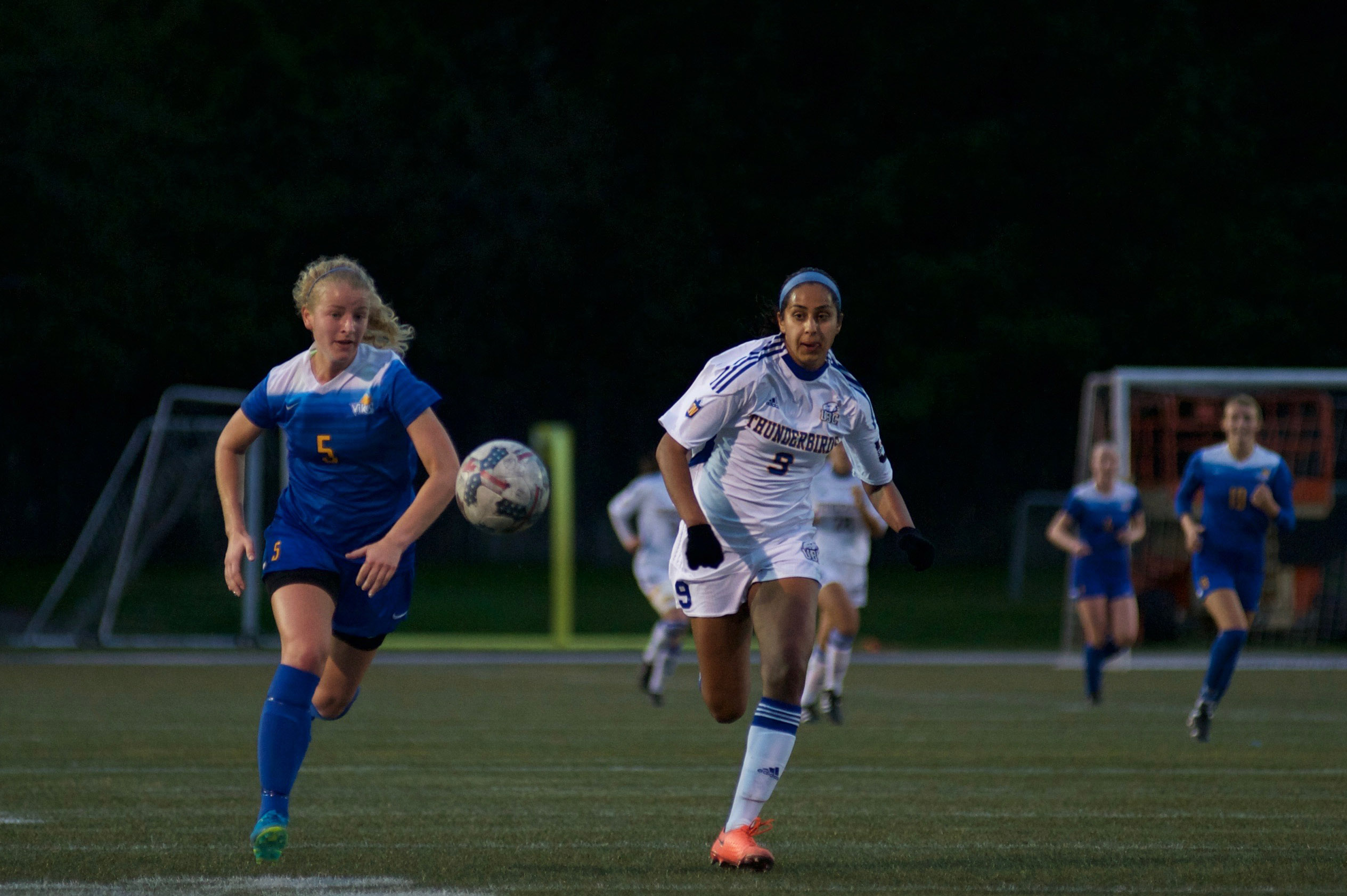 UBC's Jasmin Dhanda strides ahead in a foot race against Vikes defender Katie Carrothers.