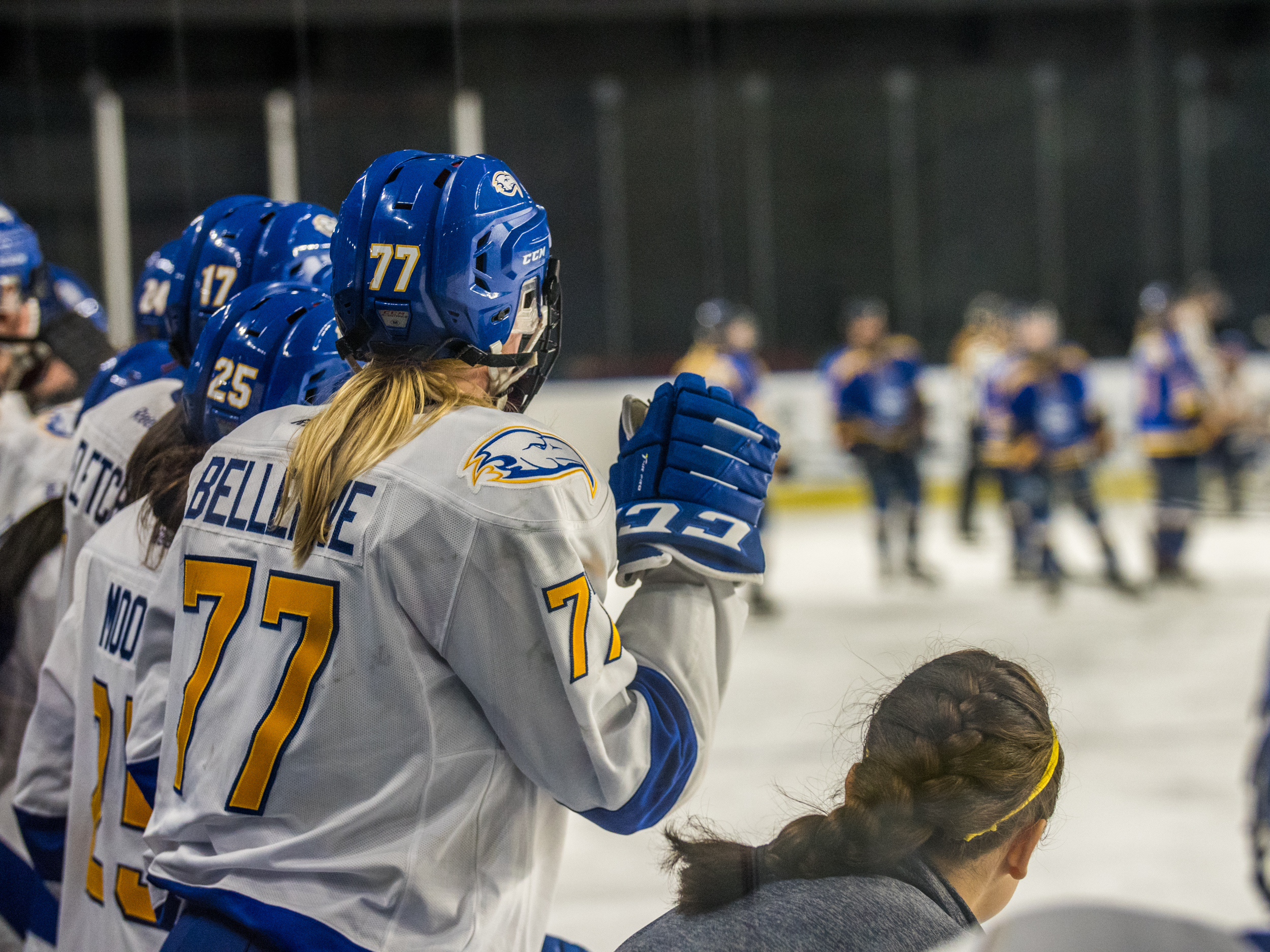 Brielle Bellerive looks on at the game with her UBC women's hockey teammate oct 28