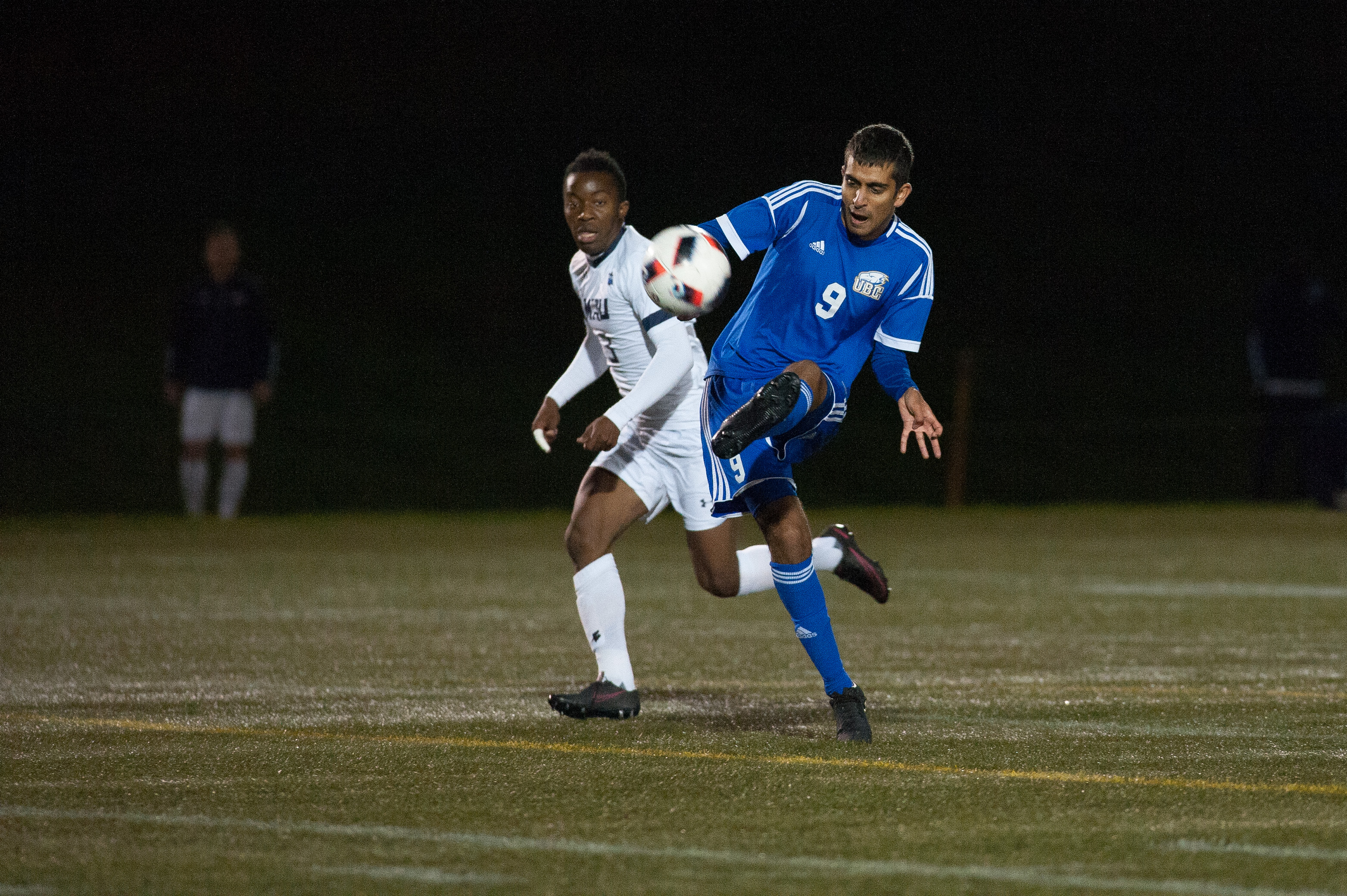 UBC's Kyle Sohi makes the touch for the tie-breaking goal in extra time.