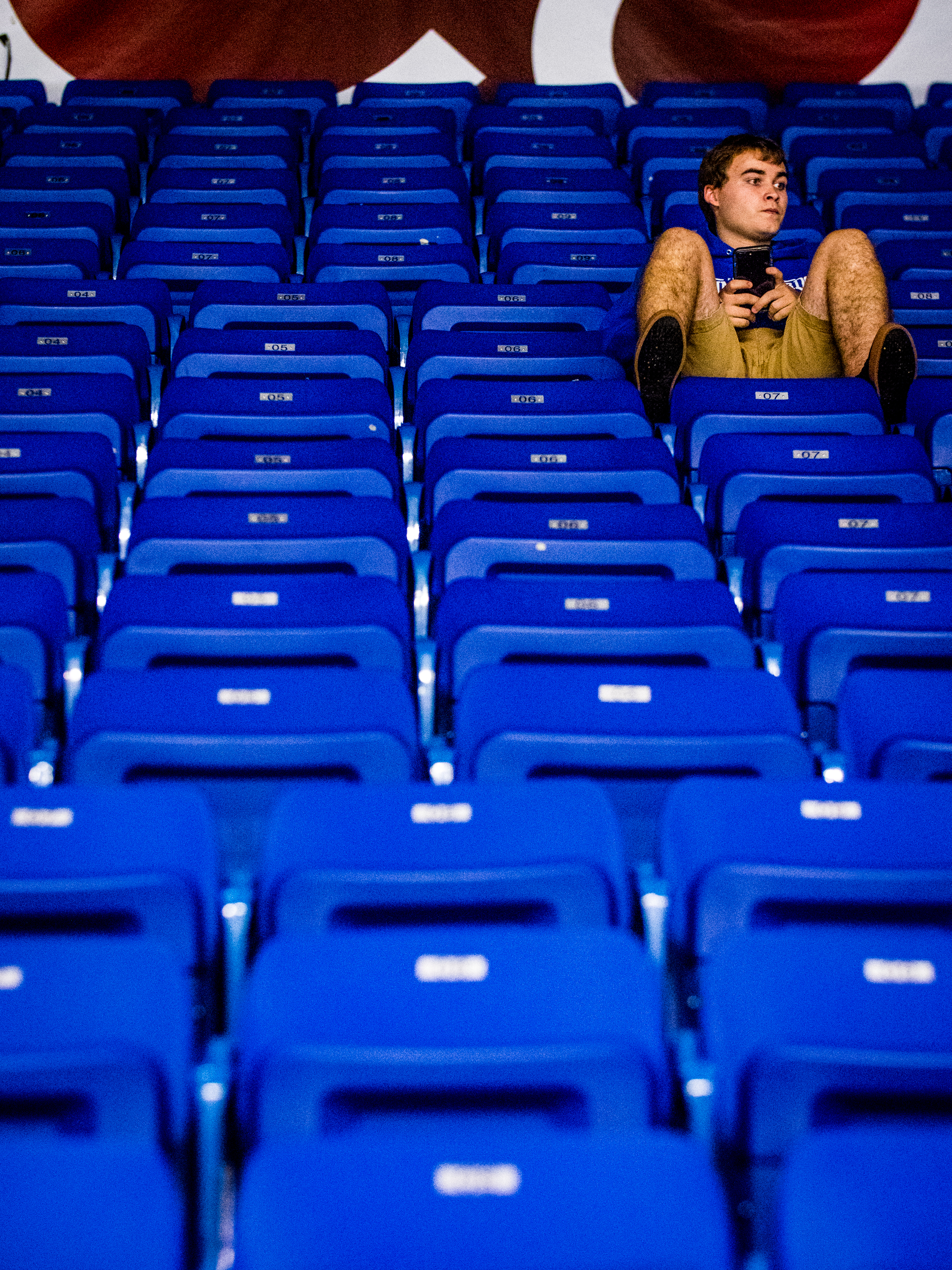 A fan watches on as UBC takes on Lethbridge.
