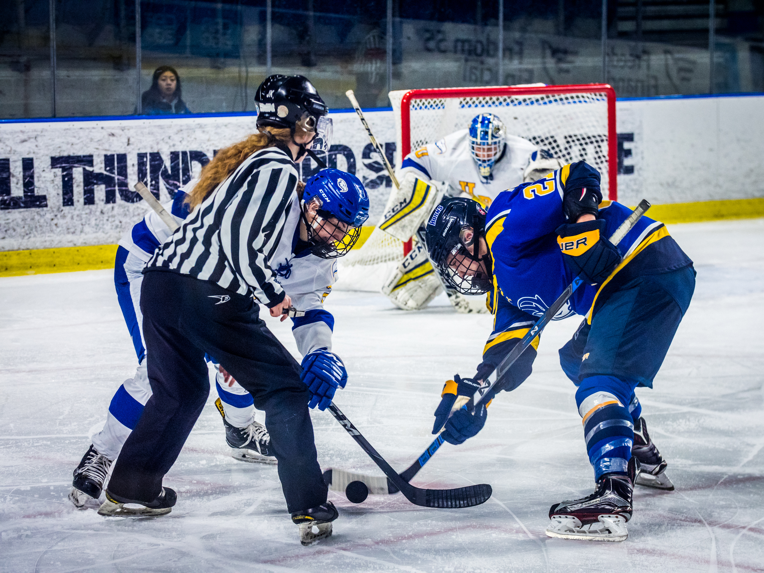 UBC and Lethbridge face off inside the Thunderbirds' blue line.