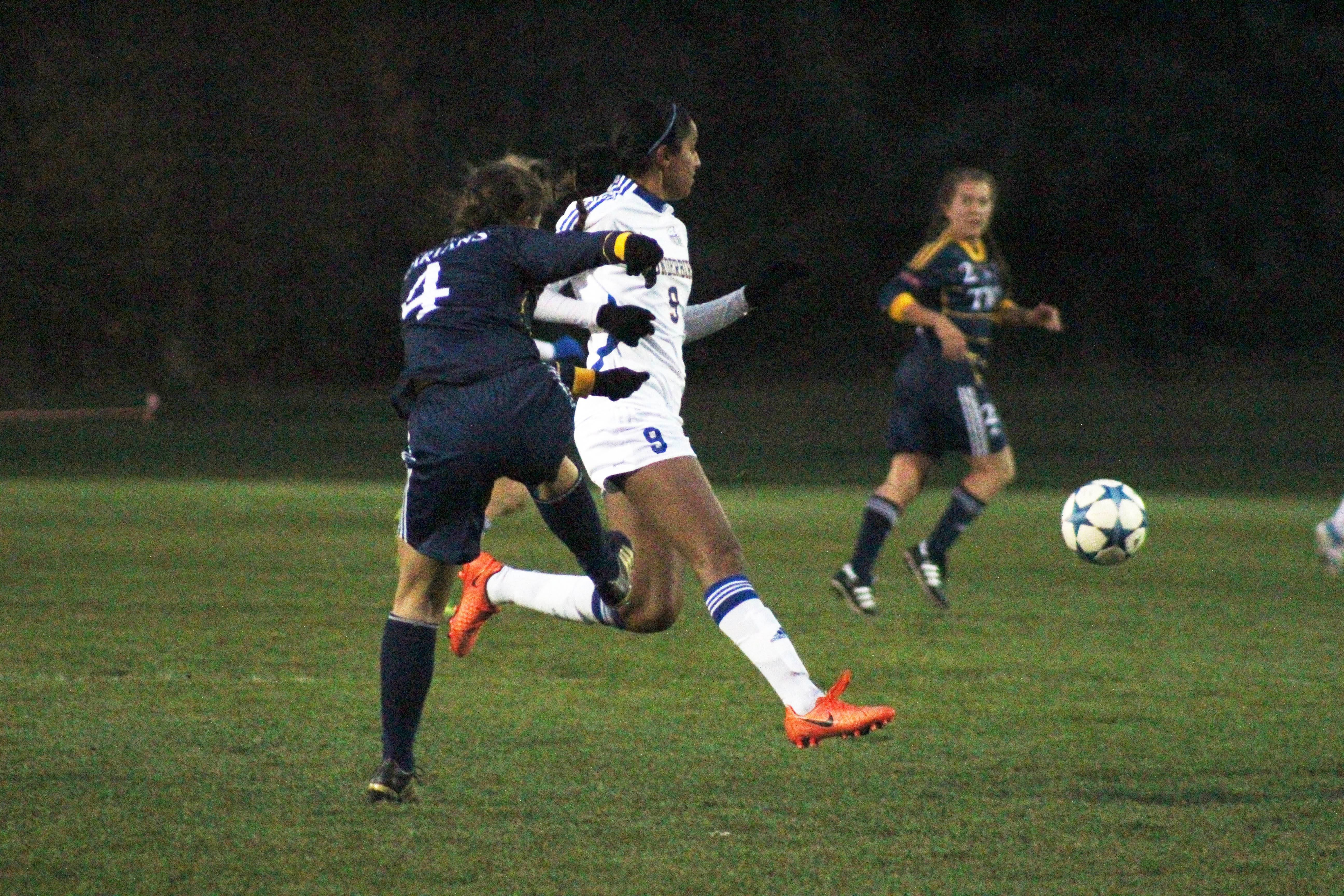 Spartans defender Elizabeth Hicks plays the ball past UBC striker Jasmin Dhanda.
