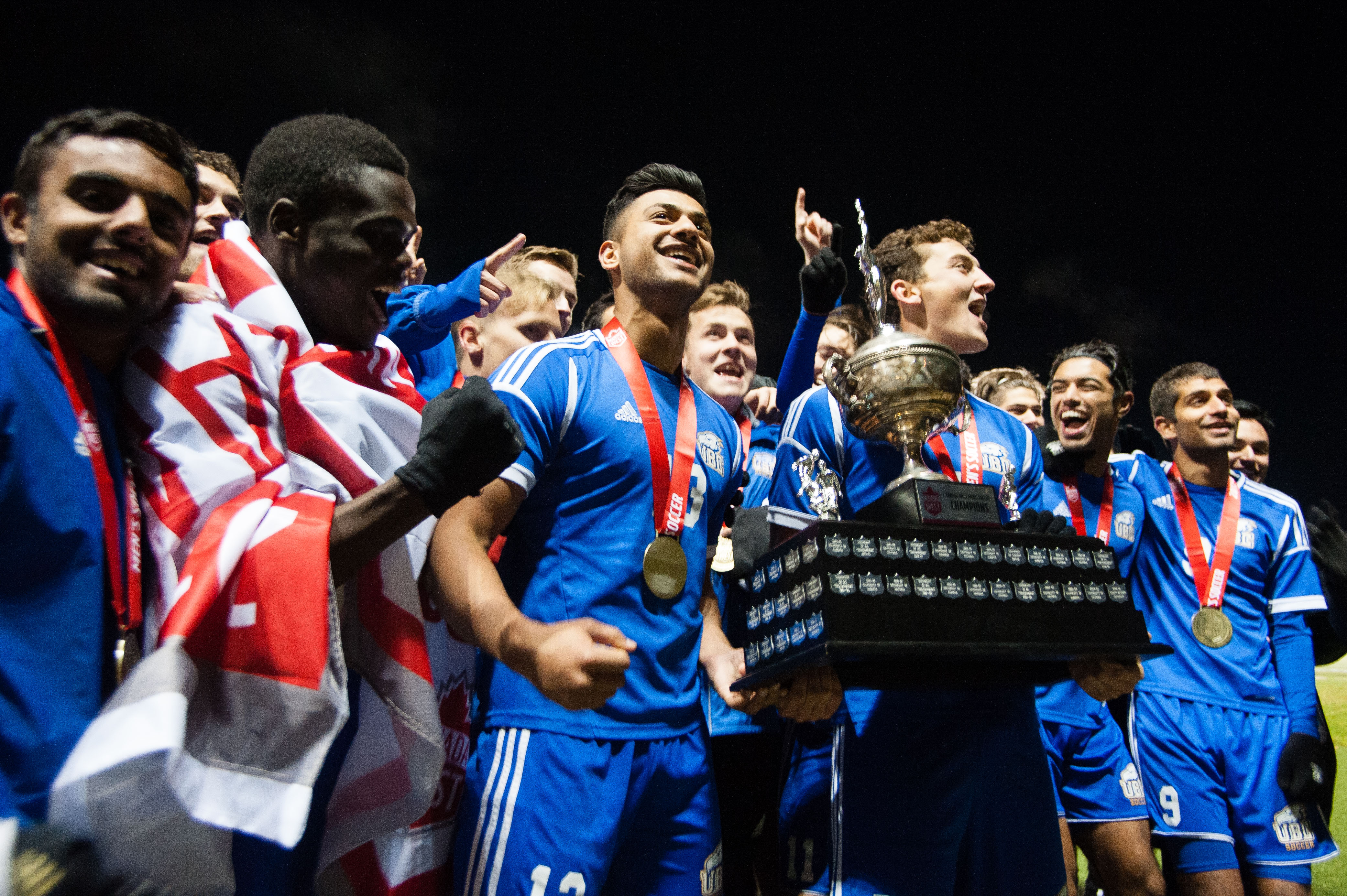 Men's soccer celebrate their Canada West title.