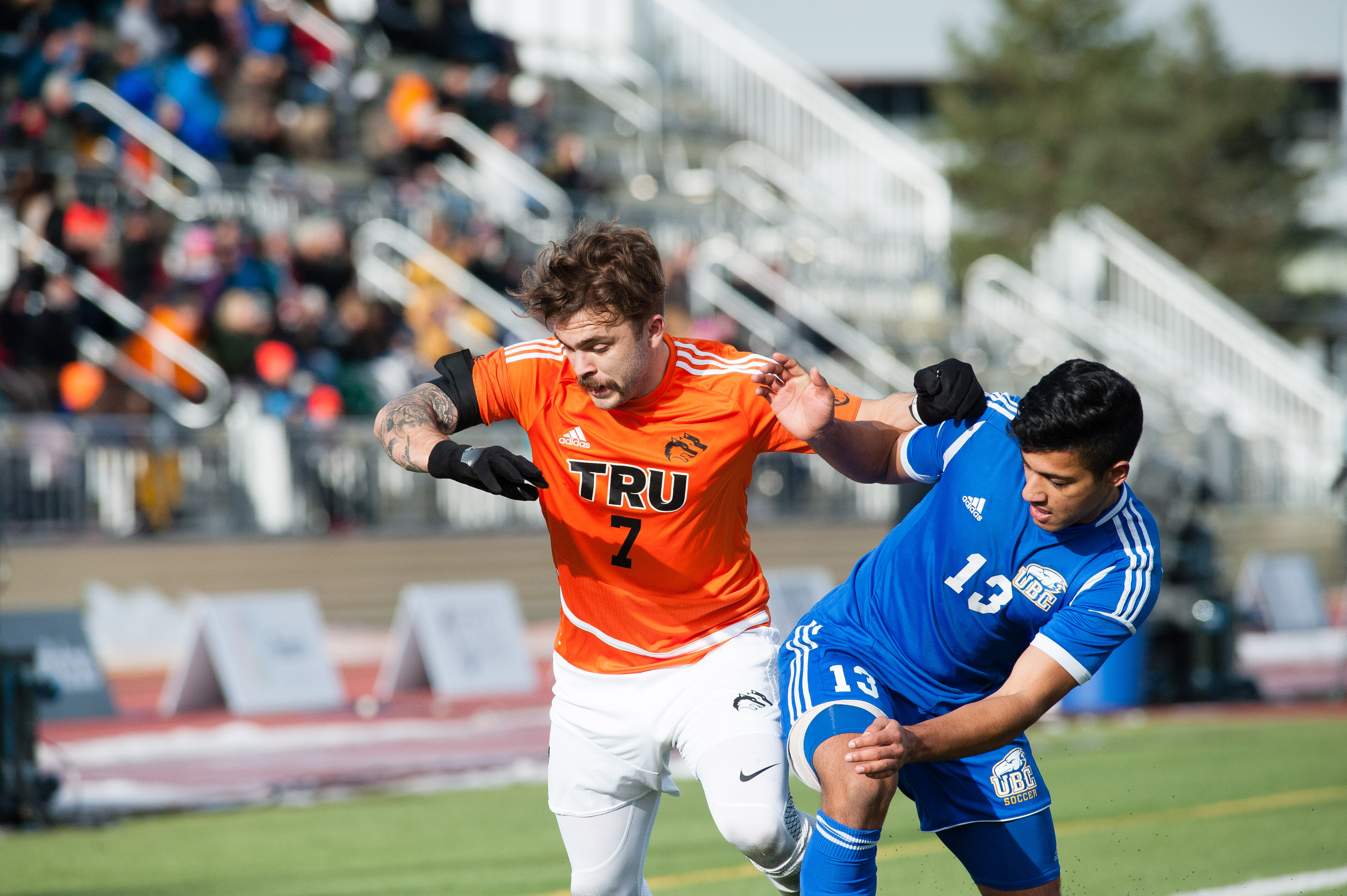Thunderbird Kerman Pannu battles against Wolfpack midfielder Justin Donaldson.