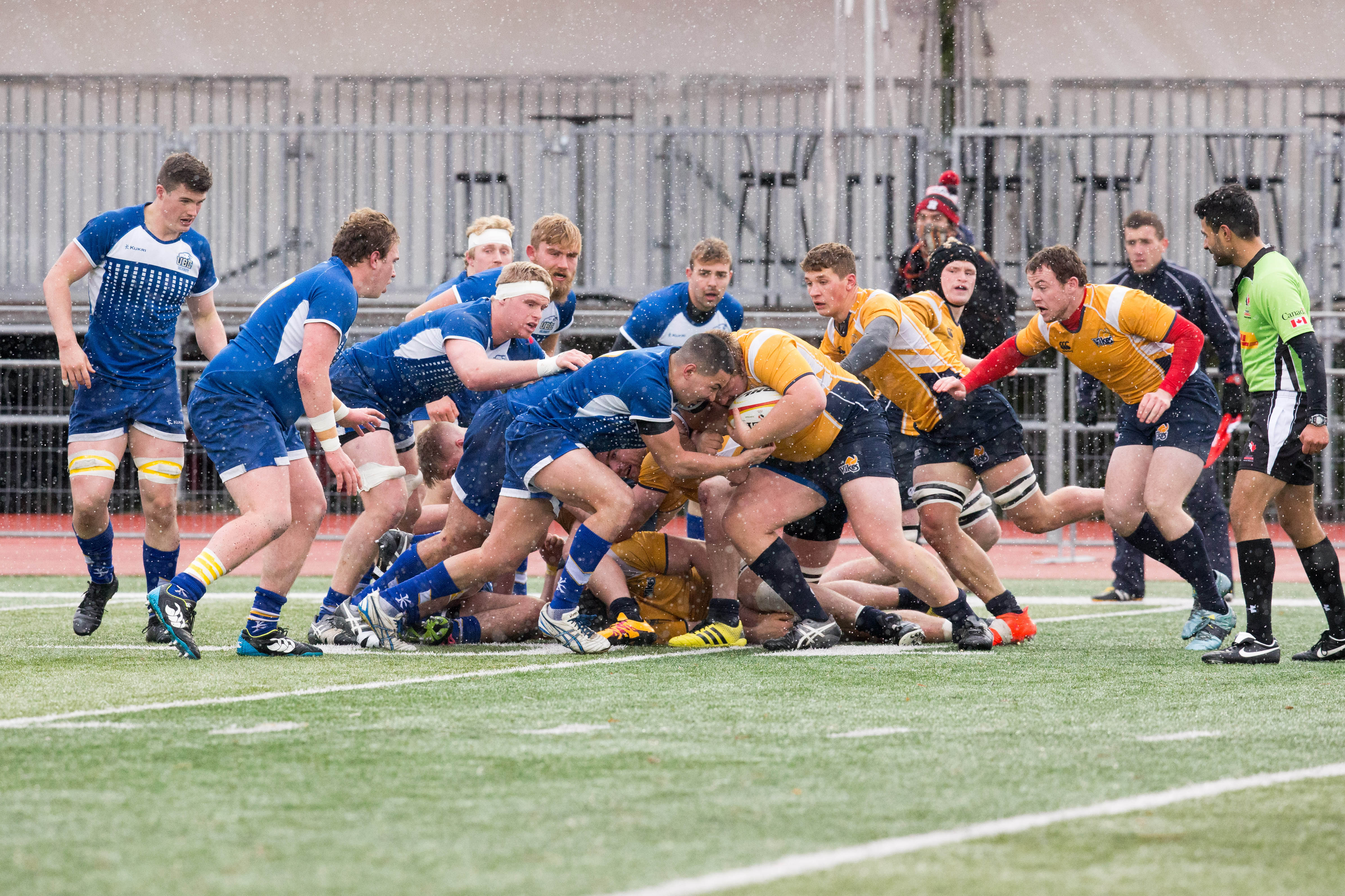 UVic stands up against UBC's defensive line.