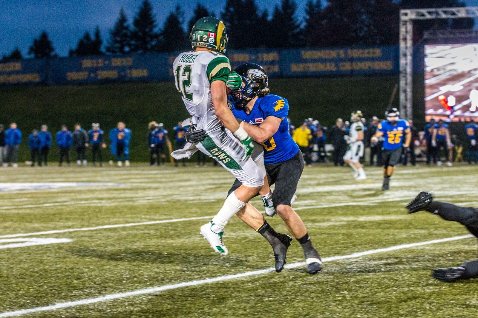 UBC smothers Rams slotback Thomas Huber.