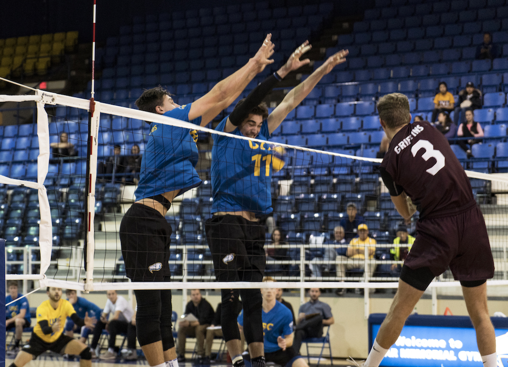 T-Birds Byron Keturakis and Fynn McCarthy jump to block a Griffins spike.