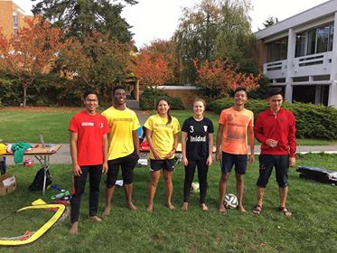 Members of UBC's Grassroot Soccer club taking a break from an event.