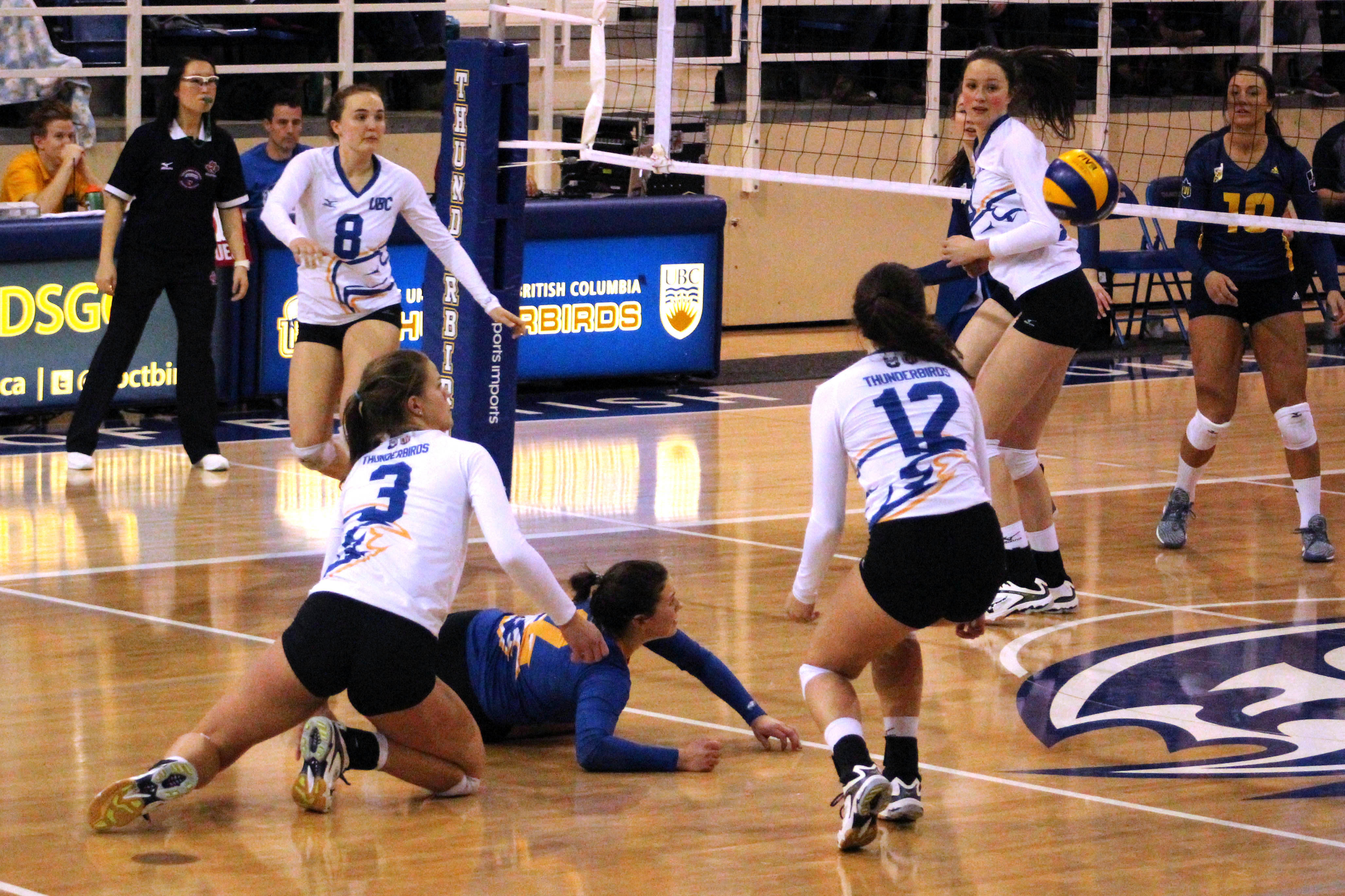 Libero Sam Patko dives to save the play for UBC.
