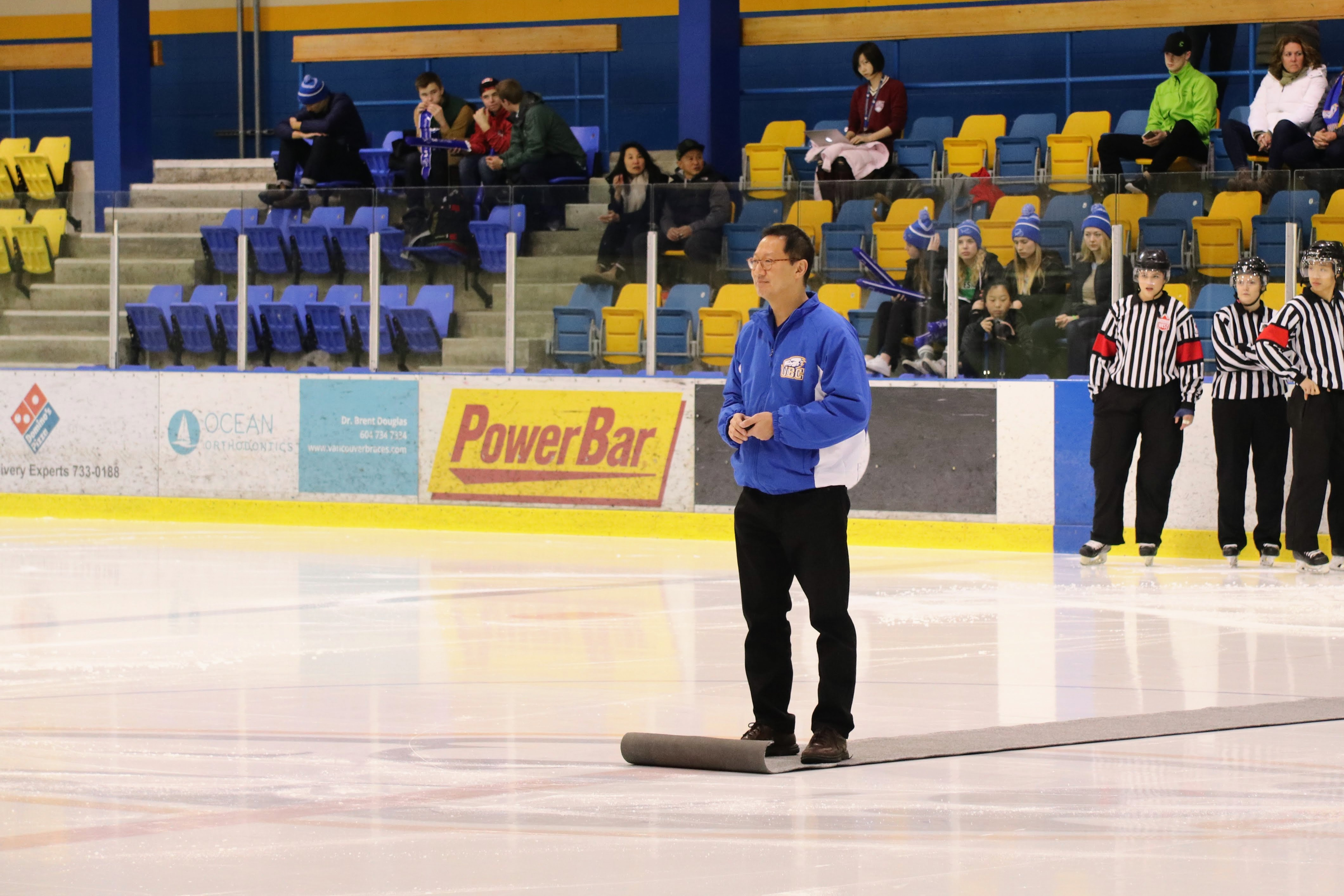 President Santa Ono sets up for the ceremonial puck drop.