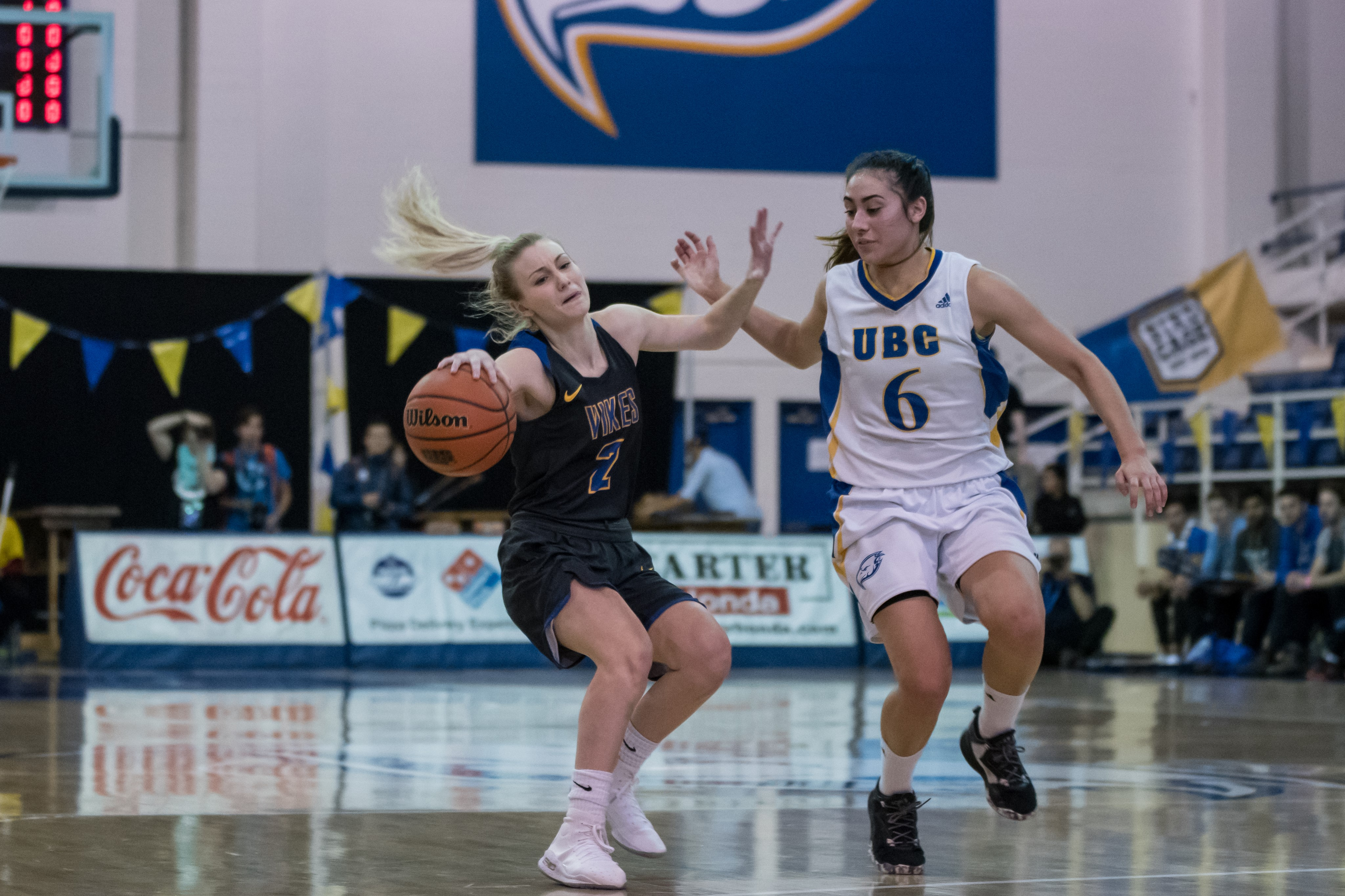 UVic's Calli McMillan protects the ball from Ali Norris.