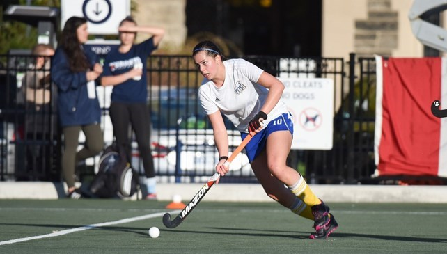 Margaret Pham moves the play upfield.