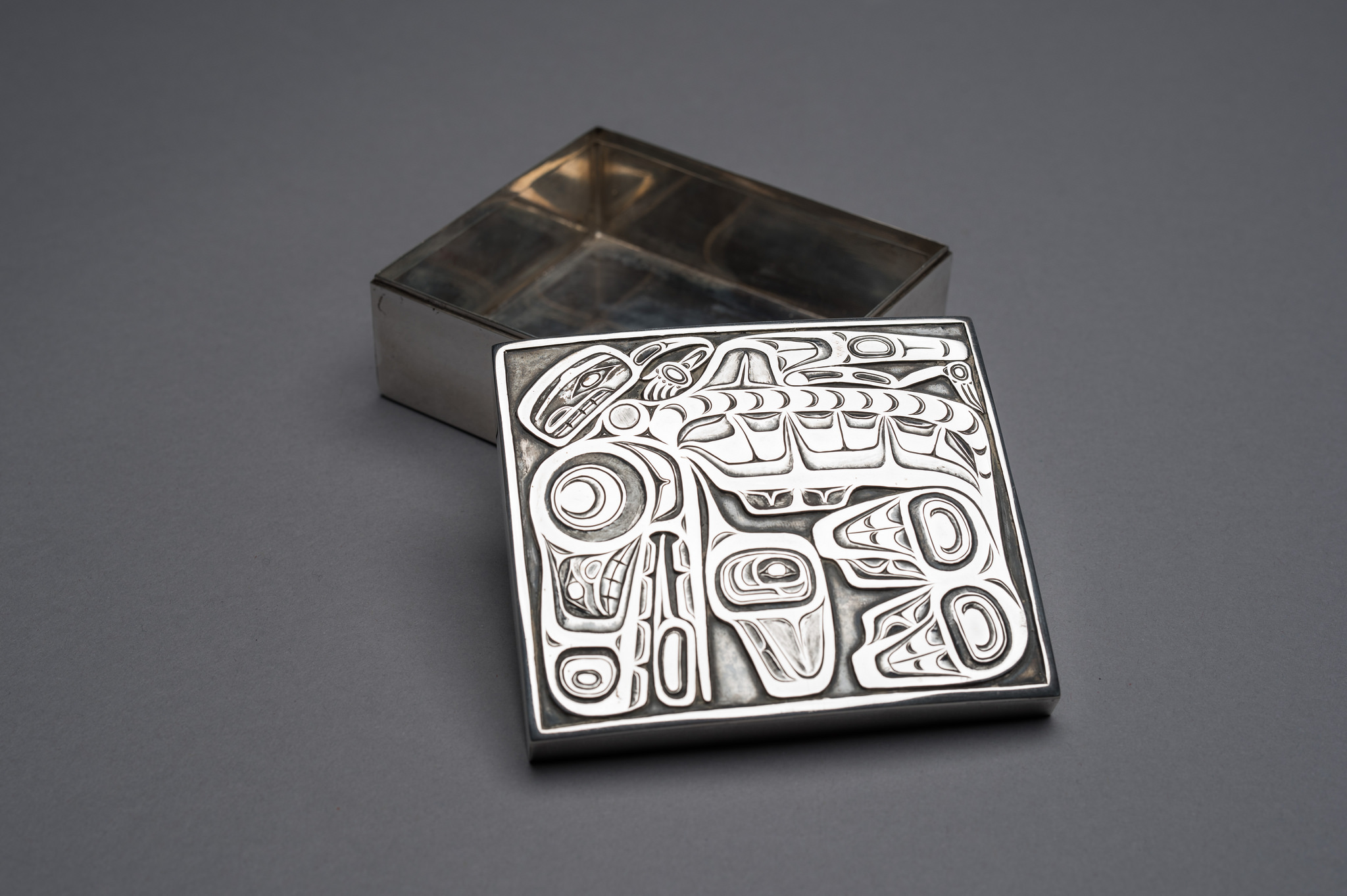 A silver box with a killer-whale motif created by renowned Haida artist Bill Reid circa 1958