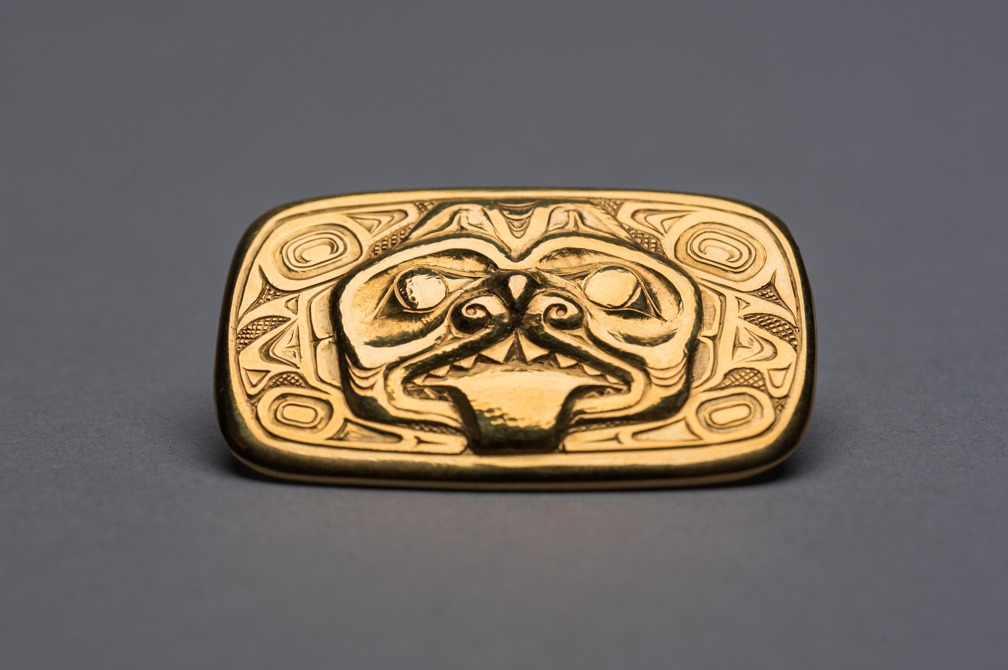 A gold brooch with a dogfish motif, circa 1963, created by renowned Haida artist Bill Reid