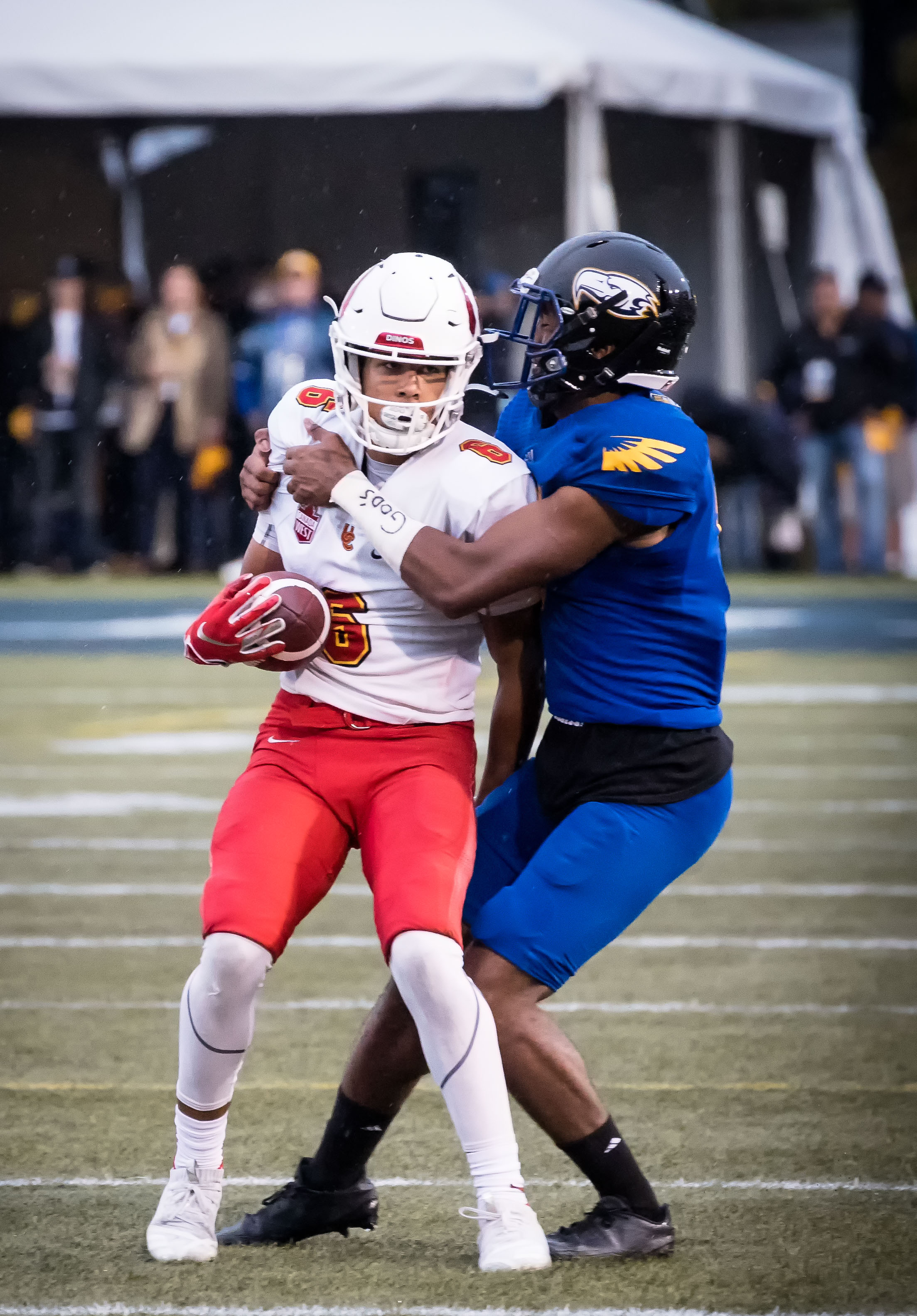 Calgary fends off a UBC tackle.