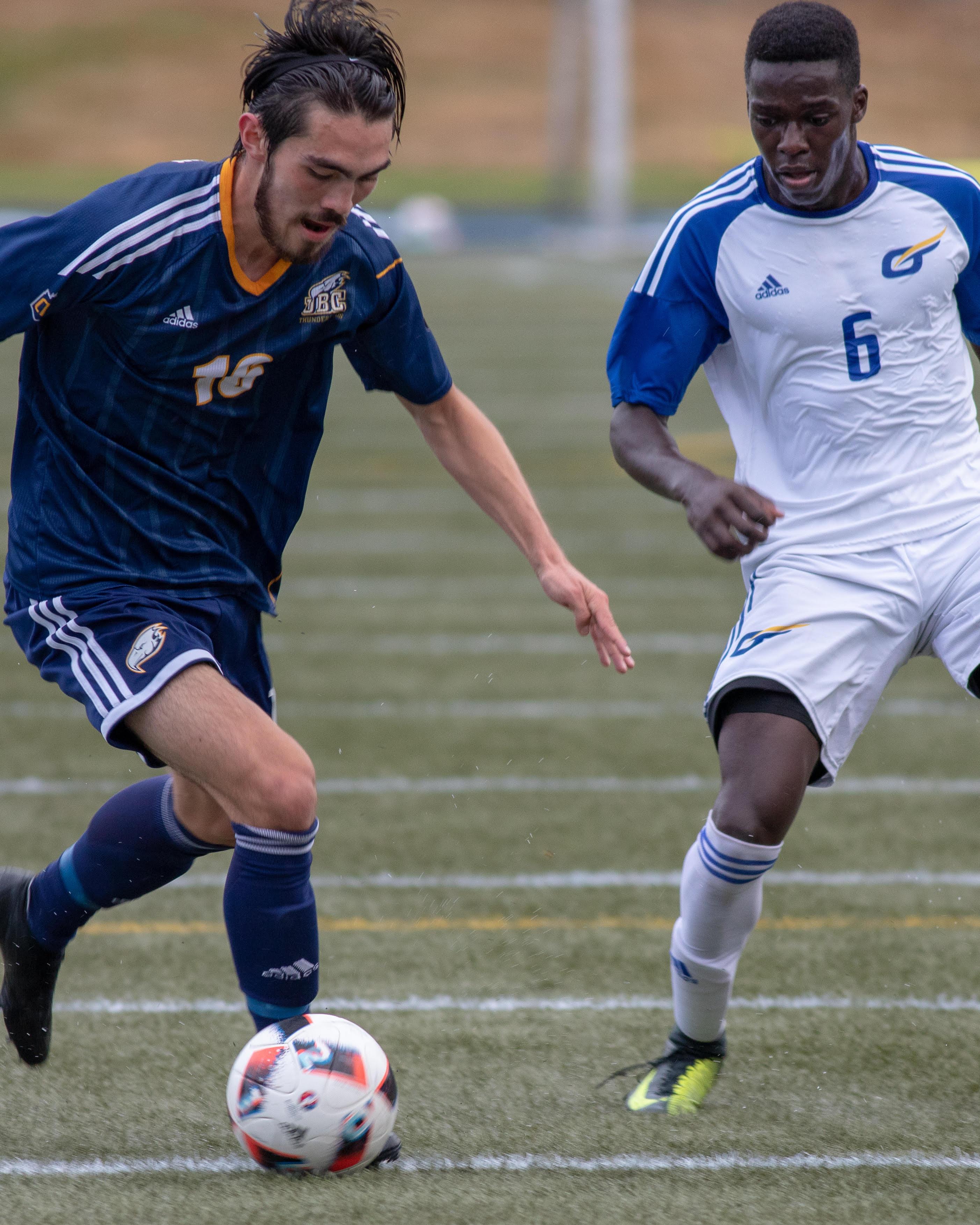 UBC's Taiyo Marzalik takes on UBCO's Aaron Maluma.