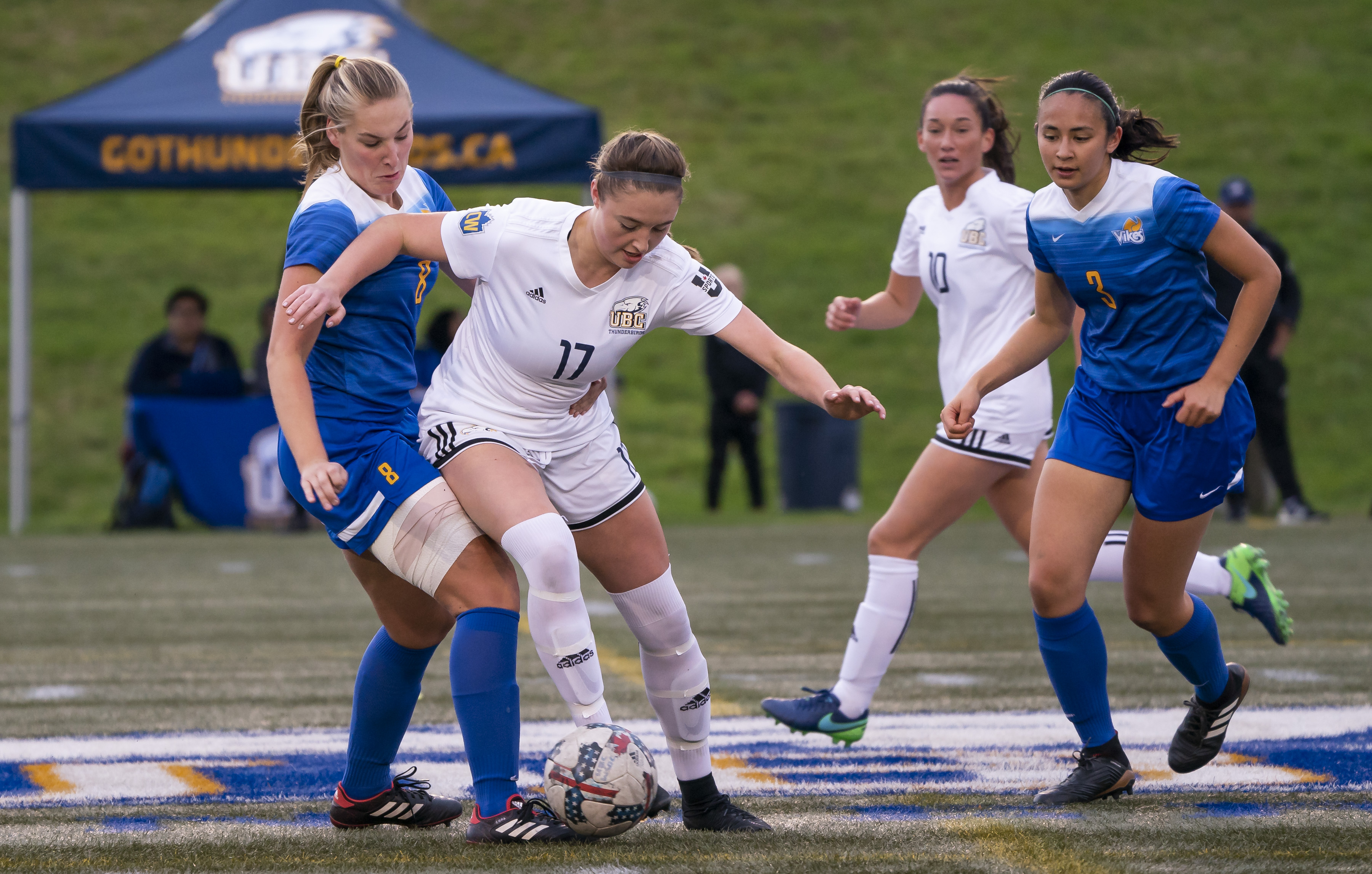 Danielle Steer shields the ball from UVic defender Kennedy Martin.