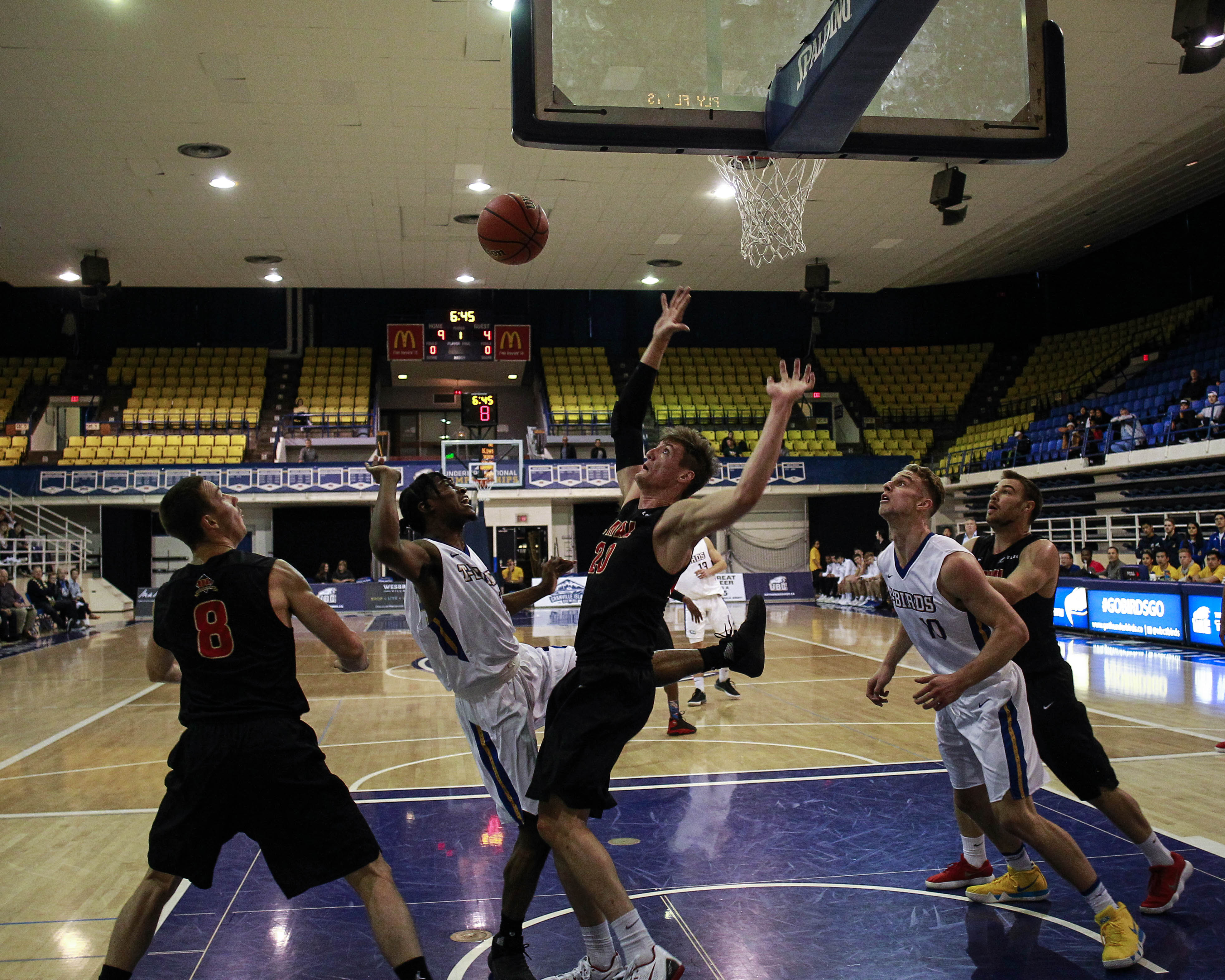 UBC scrambles for the ball in the paint.