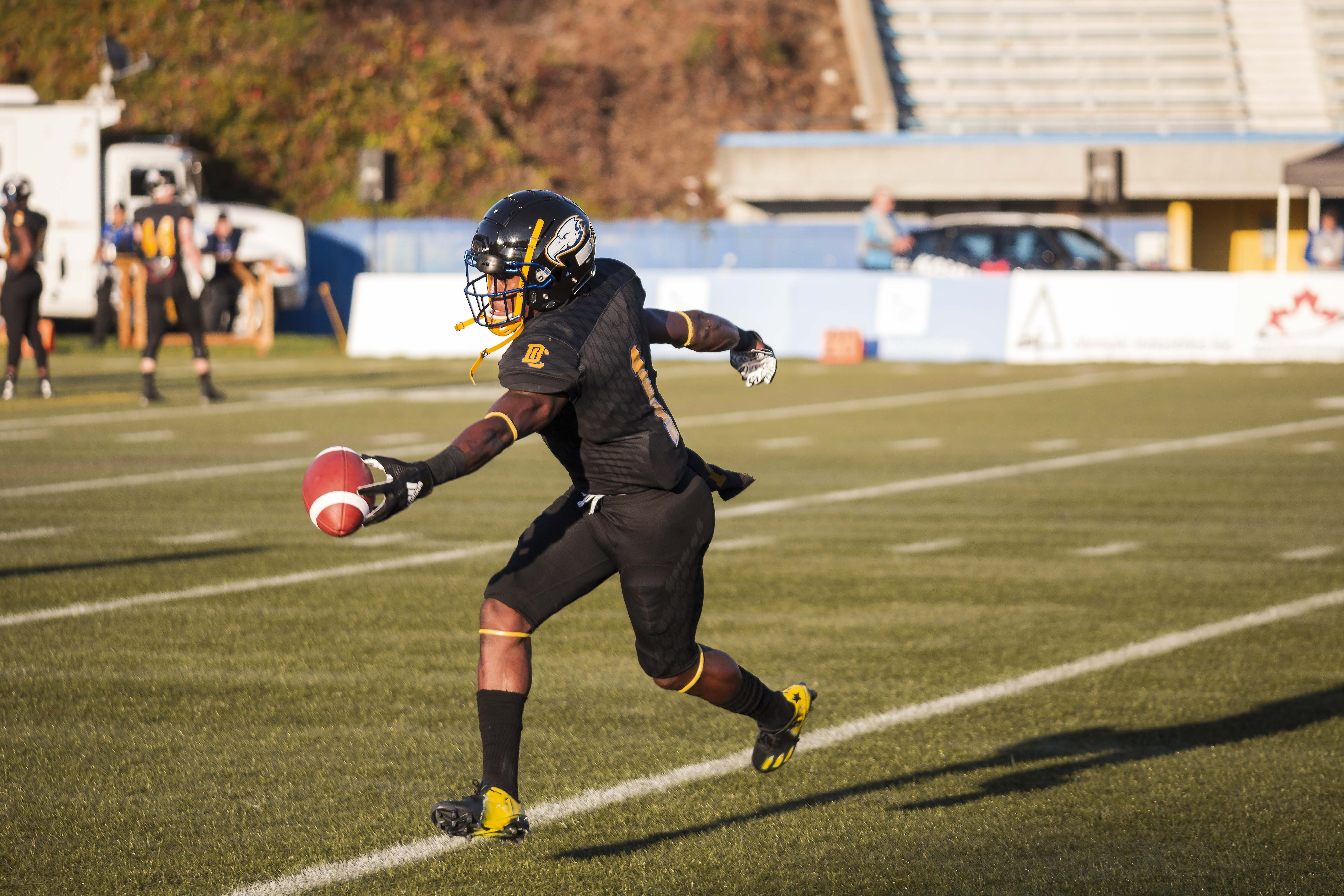 Trivel Pinto catches the football for UBC.
