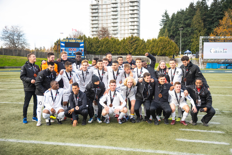 Carleton Ravens with their bronze medal.
