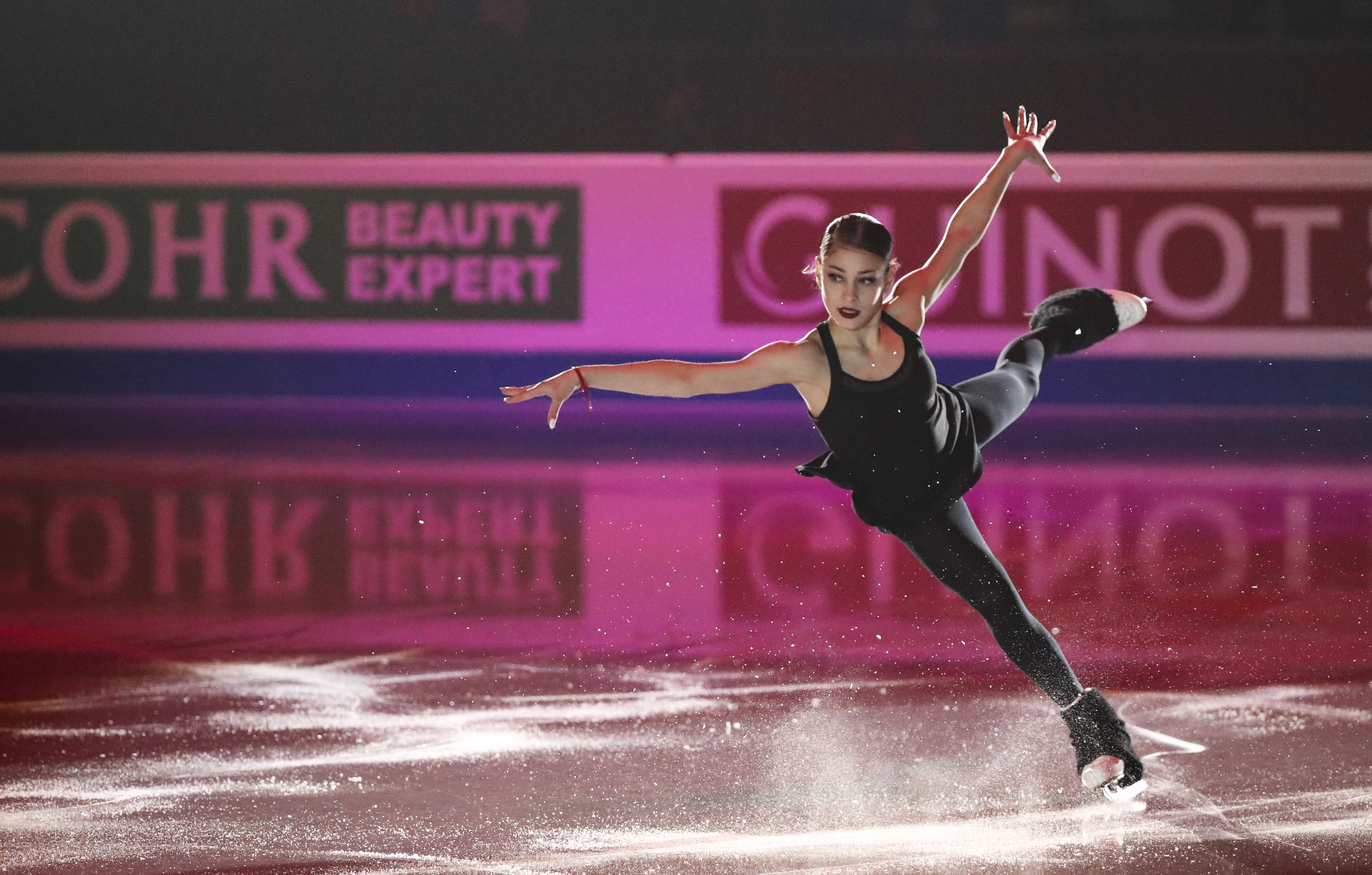 Alena Kostornaia sticks her landing.