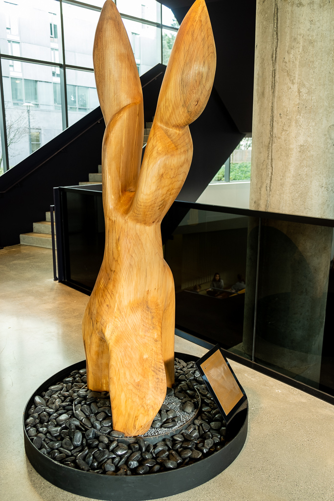 A maple wood sculpture of a dancing flame honouring Archilbald's legacy stands tall in the middle of Ponderosa Commons.