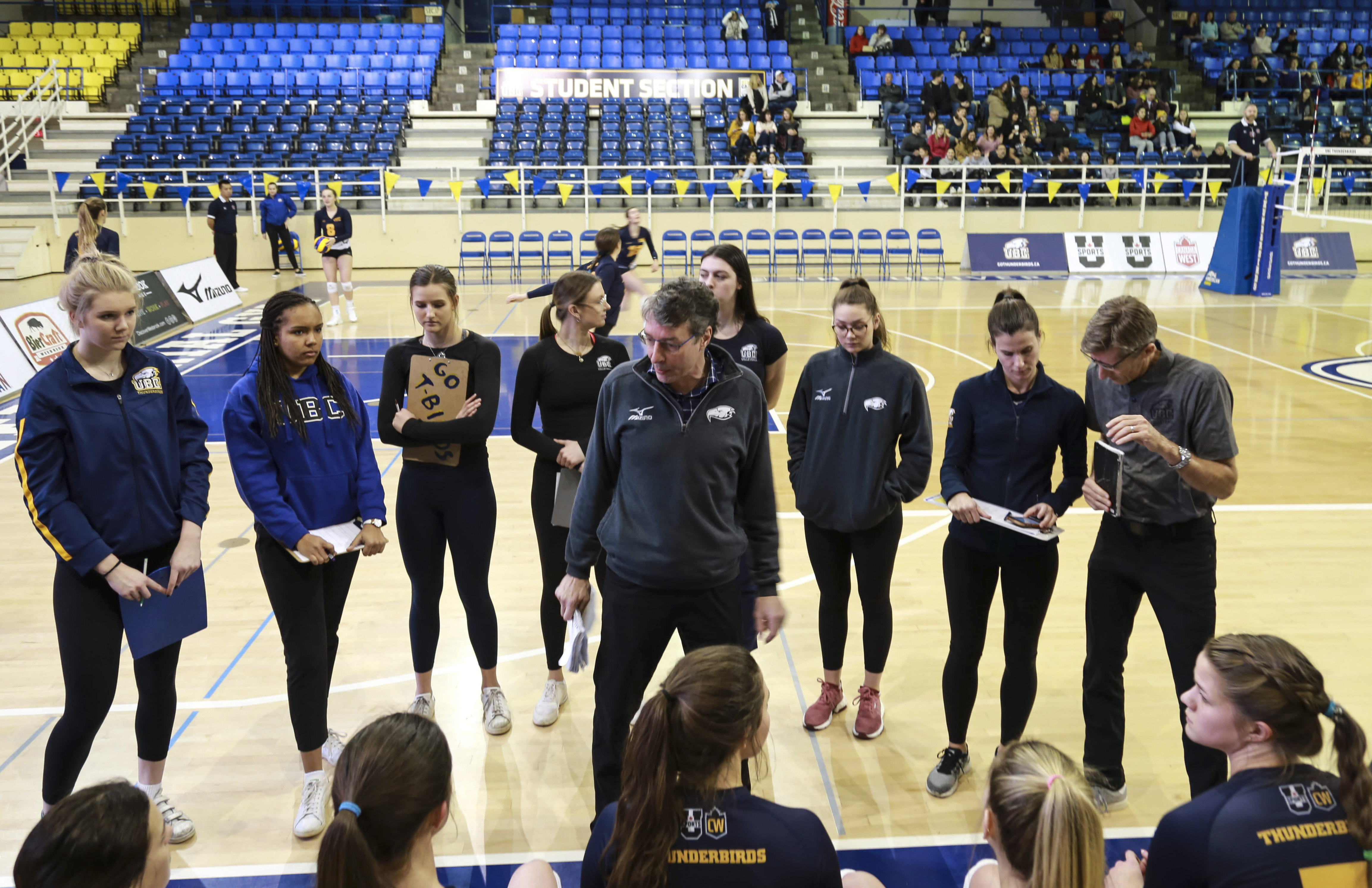 Head coach Doug Reimer speaks to the women's volleyball team.