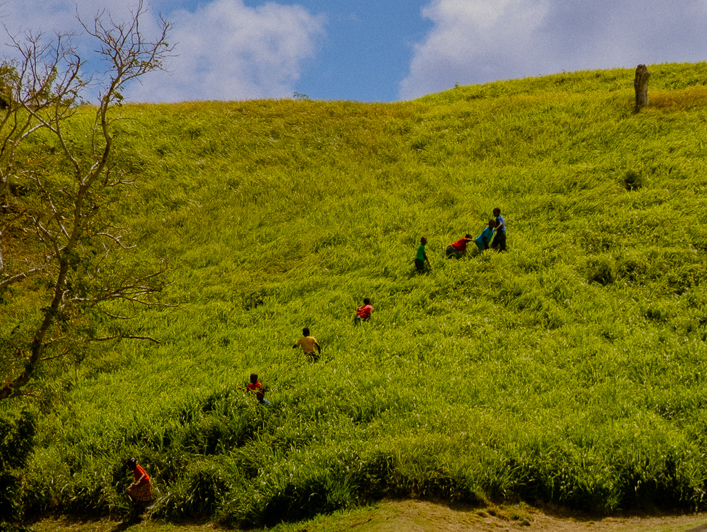 School children on a field trip climb up the side of Brimstone Hill.