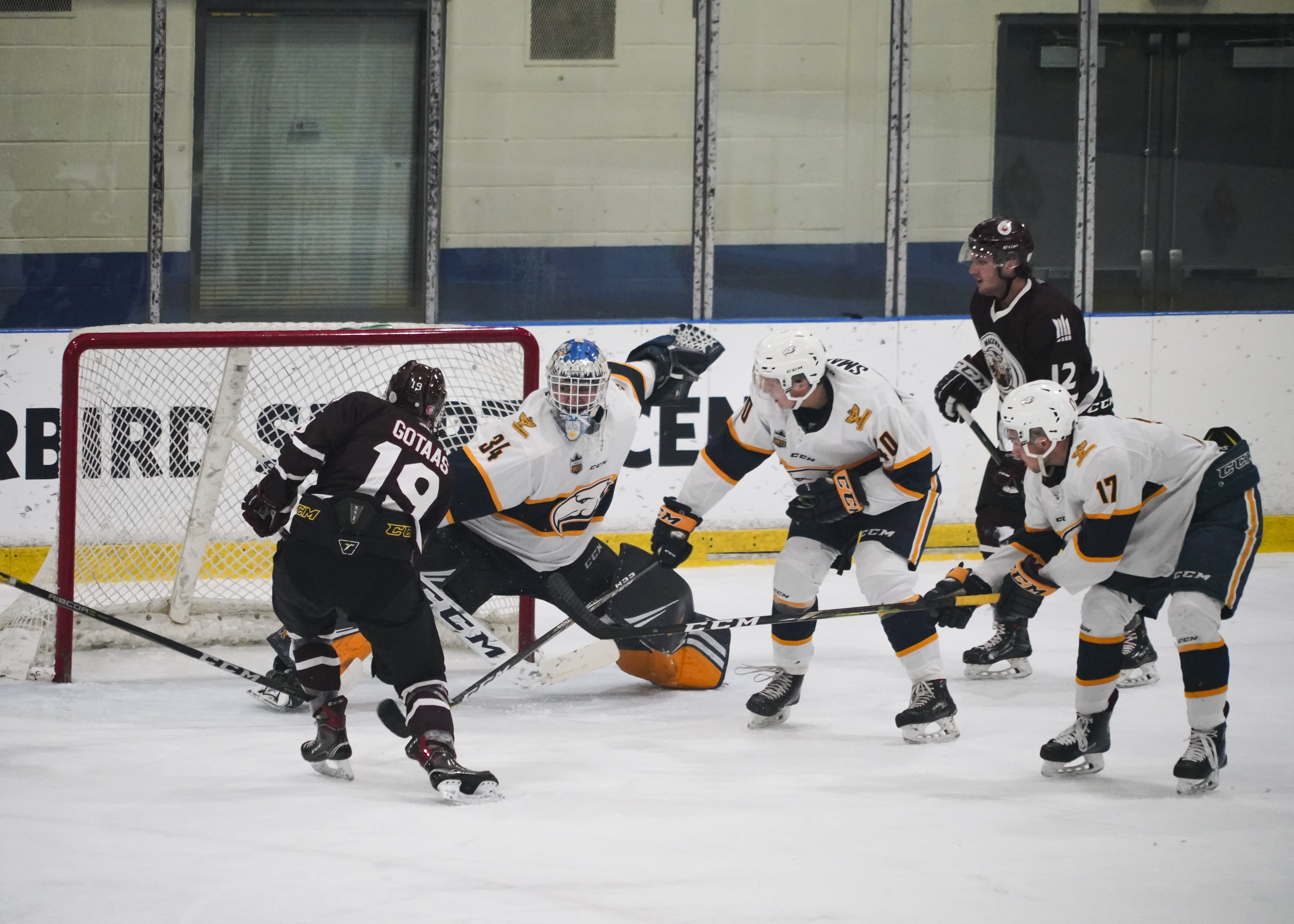 A MacEwan player takes a shot right in front of the T-Birds' net