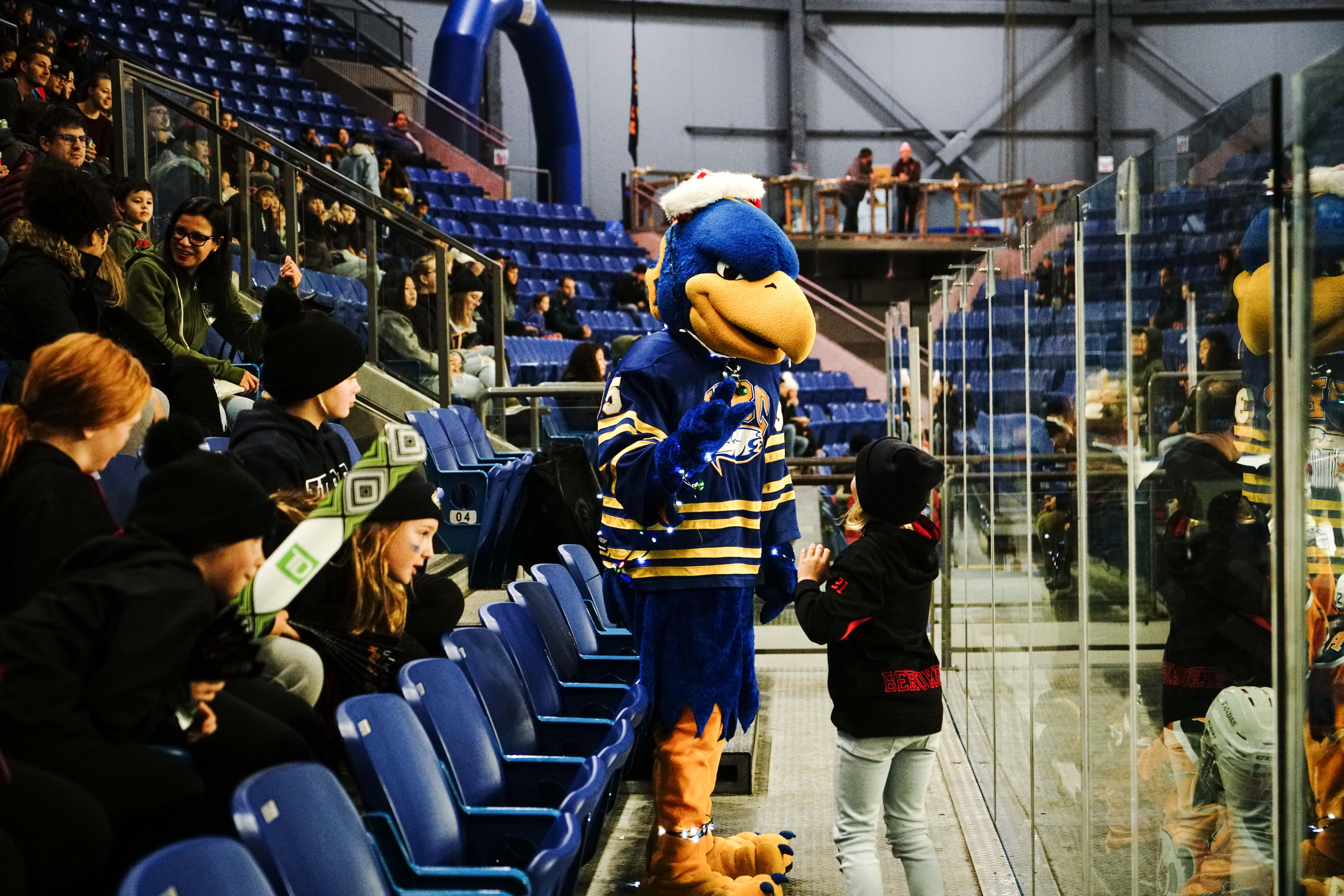 Thunder the mascot plays with a young Thunderbirds fan.