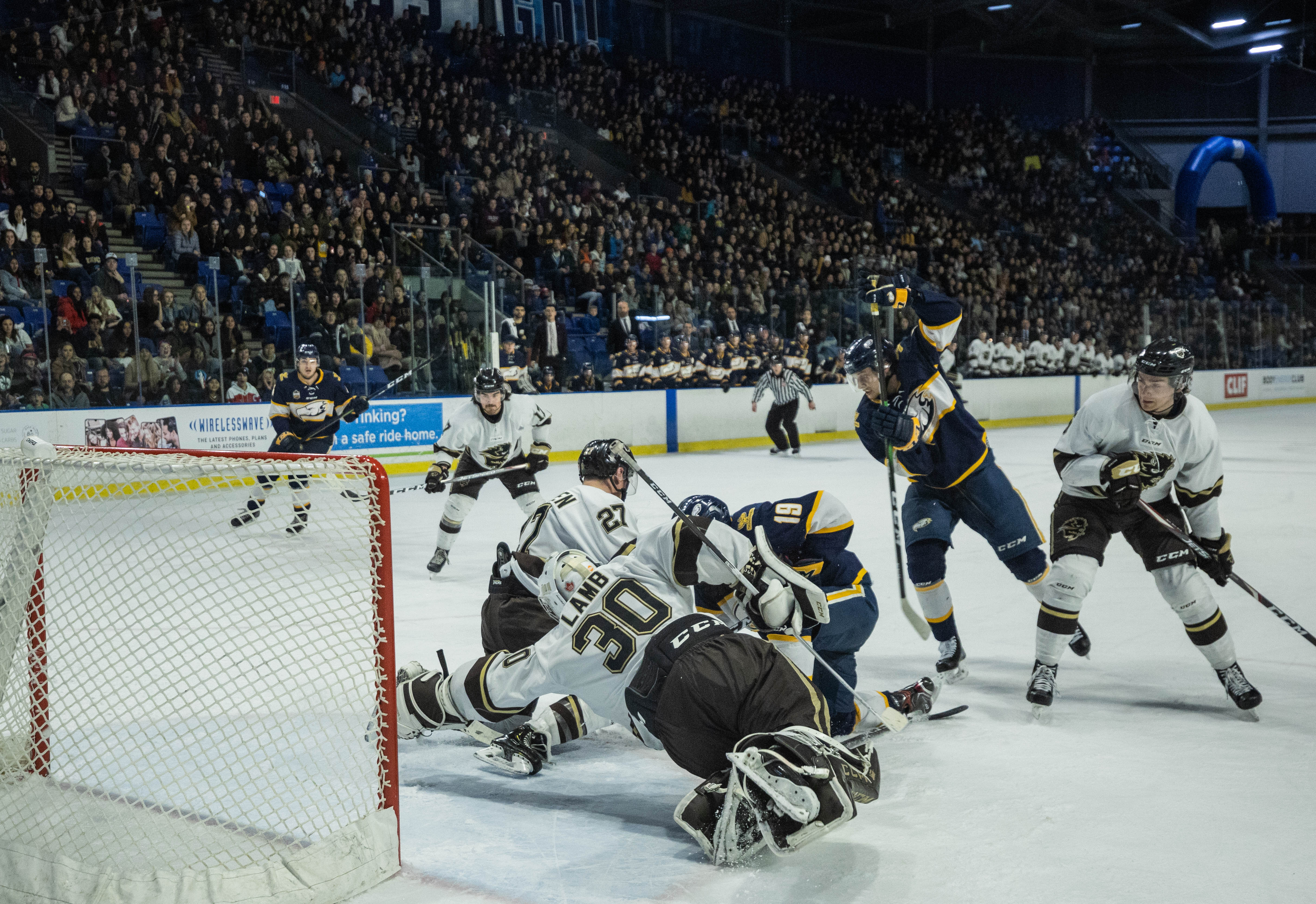 Manitoba goalie Riley Lamb makes a diving save midway through the game.