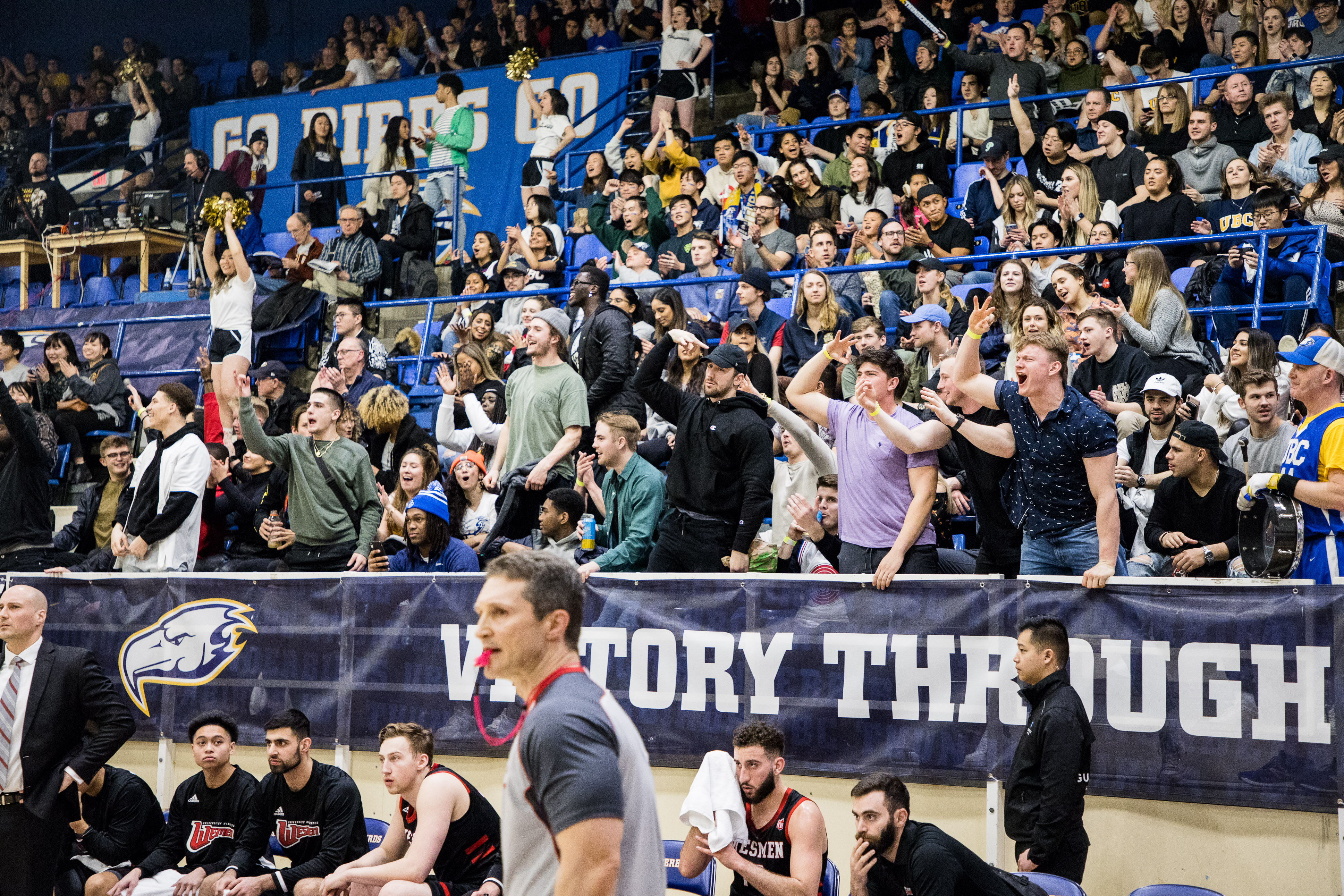 Fans yelled out after the T-Birds make a three-pointer.