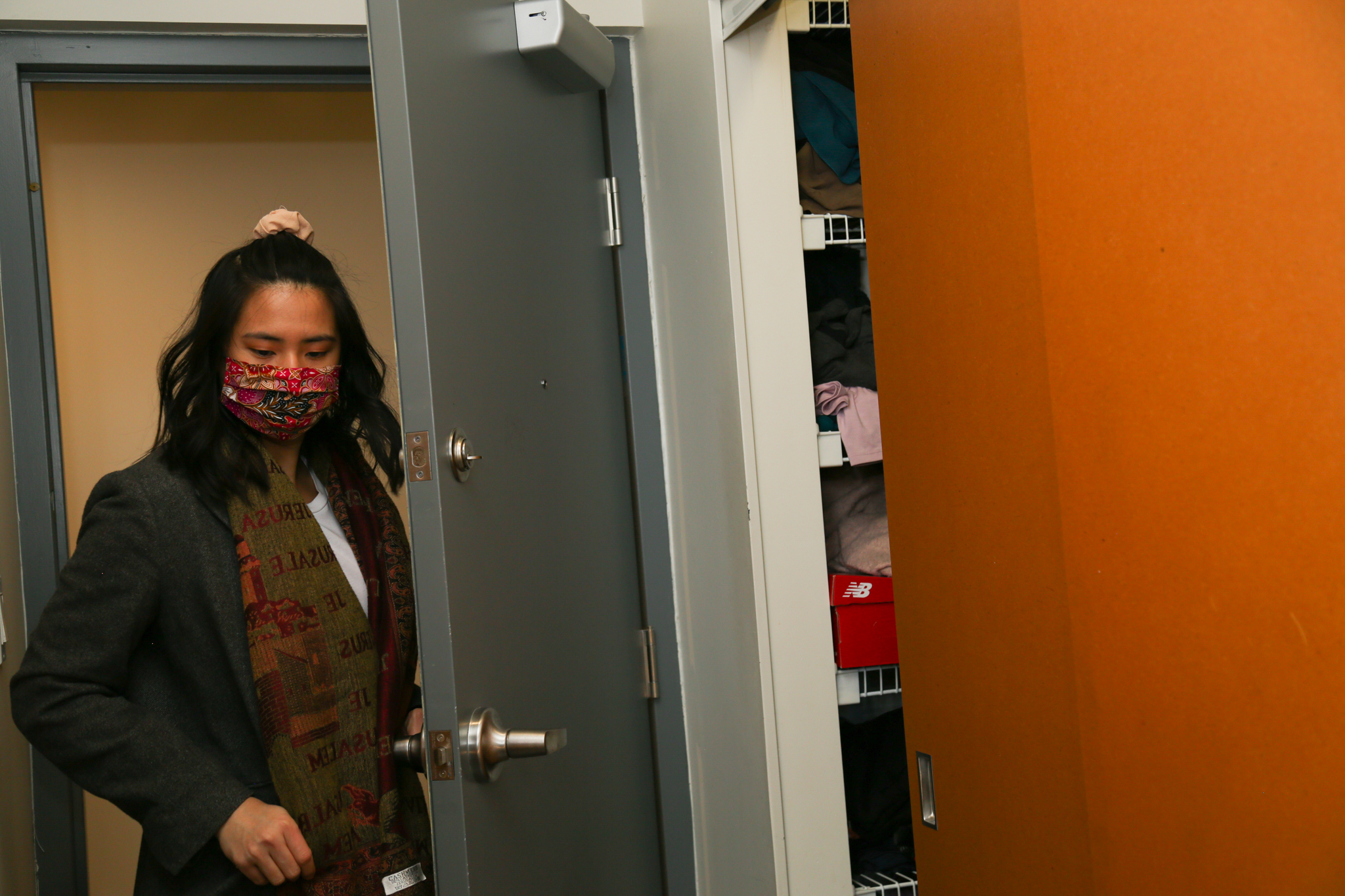 Lee heading out the door for a pandemic walk, wearing a mask made of batik — a style of textile art commonly found in Malaysia.